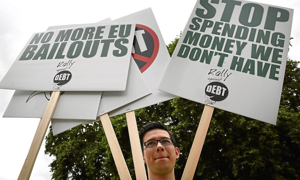 Demonstrators call for an end to the national debt outside the UK Parliament in London. Alex says whether Scotland becomes independent or not, there are debts to be paid.