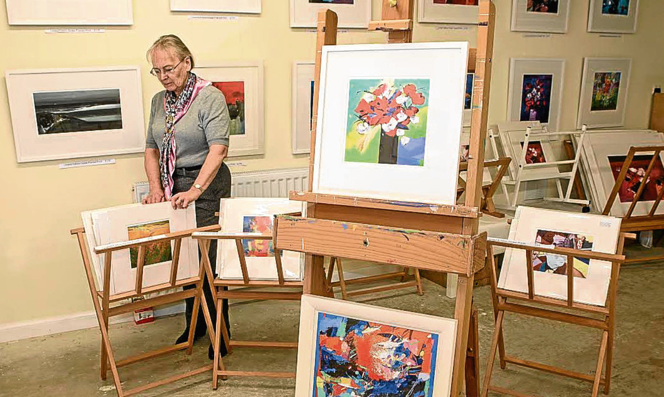 Virginia Nelson flicks through prints of her late husband John's work at  Nelson Art Prints in Pittenweem