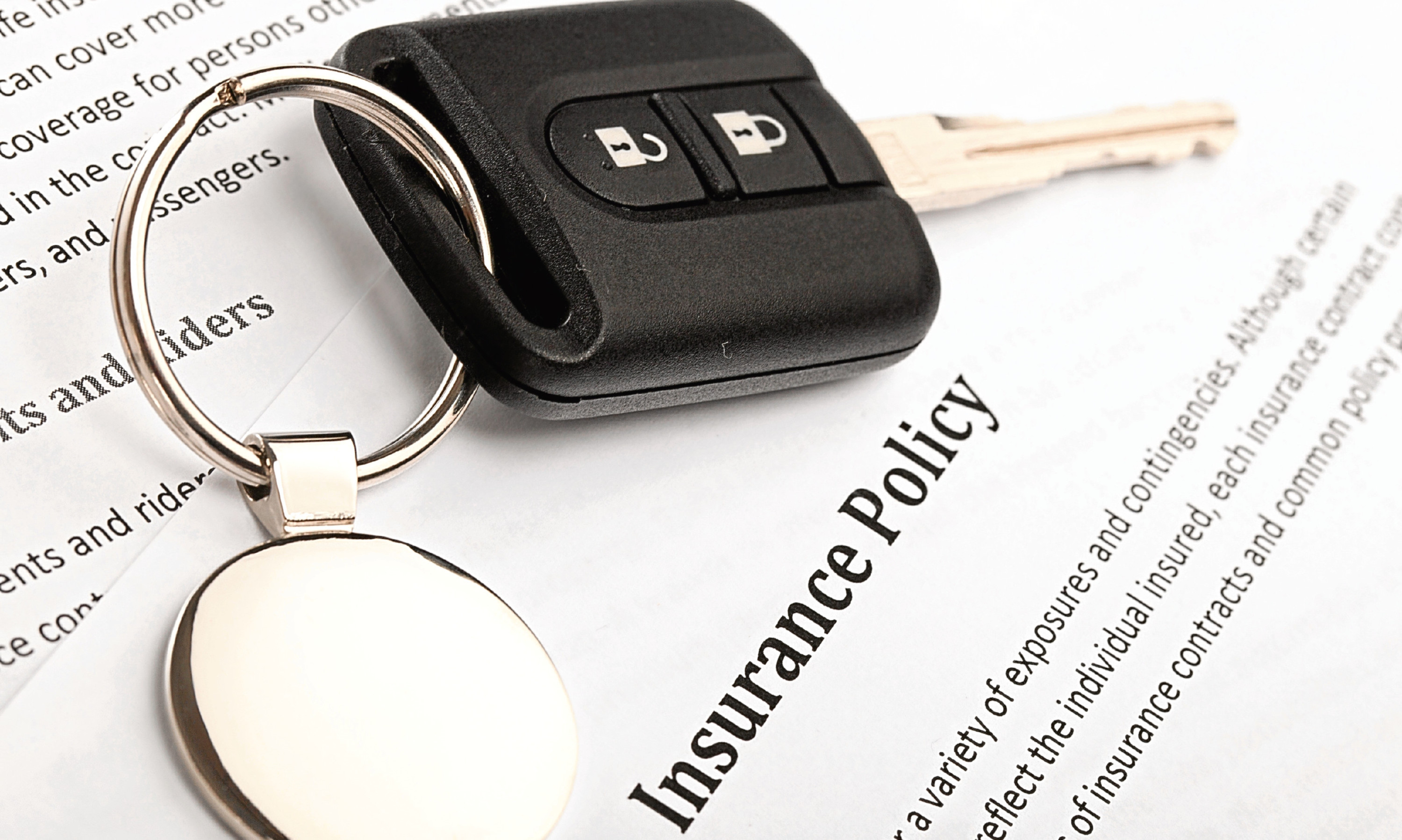 Car Key on an Insurance Policy