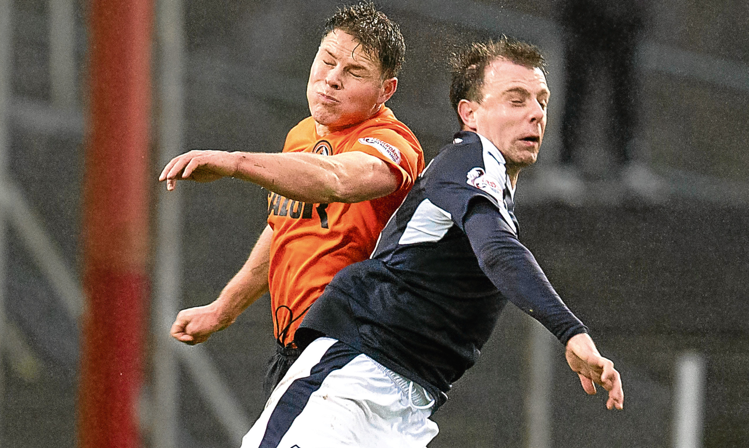 John Rankin and Paul McGowan get stuck in during one of last seasons Dundee derbies, the best fixture in Scottish football, according to Jim.