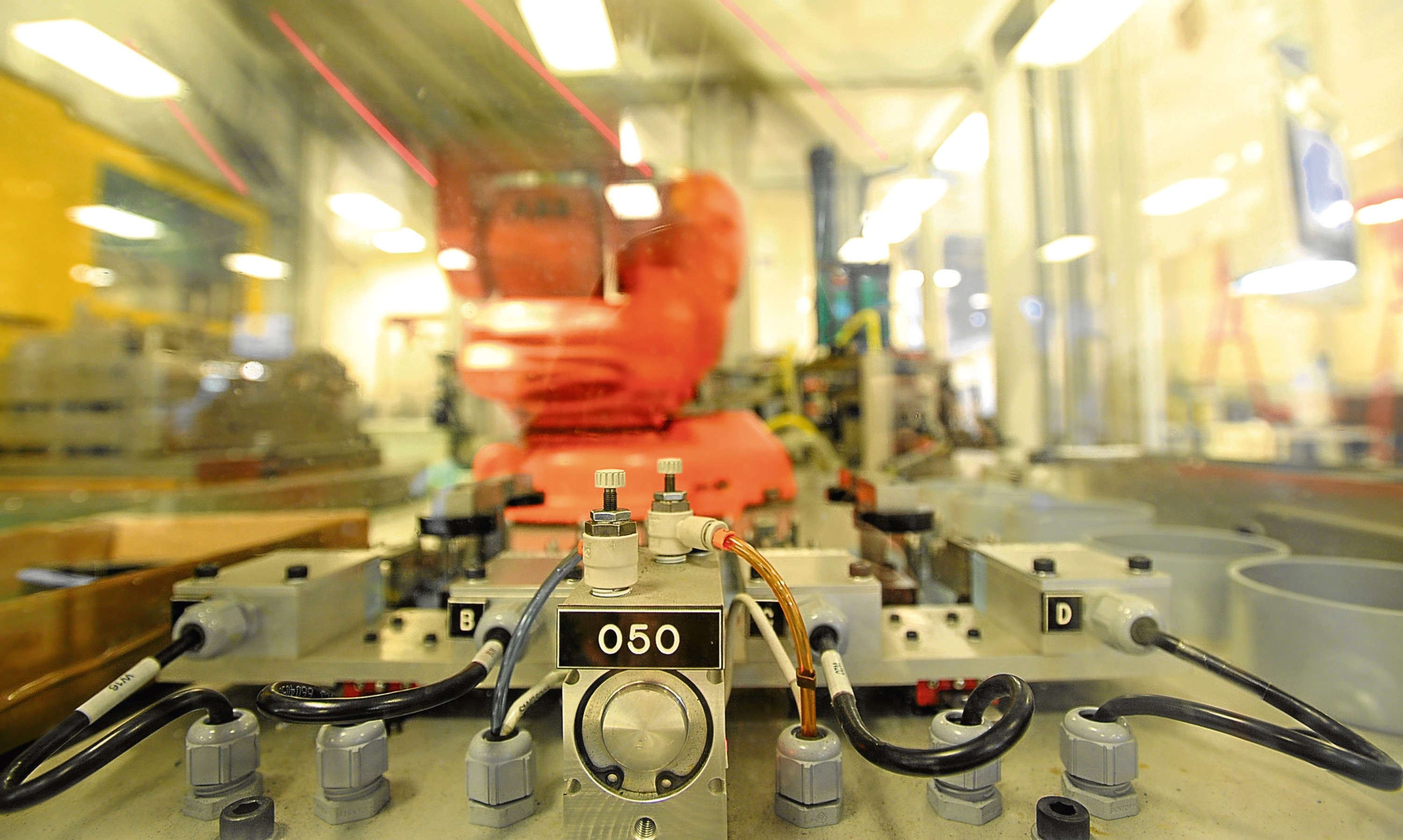 A robot carrying out a production task at Interplex PMP