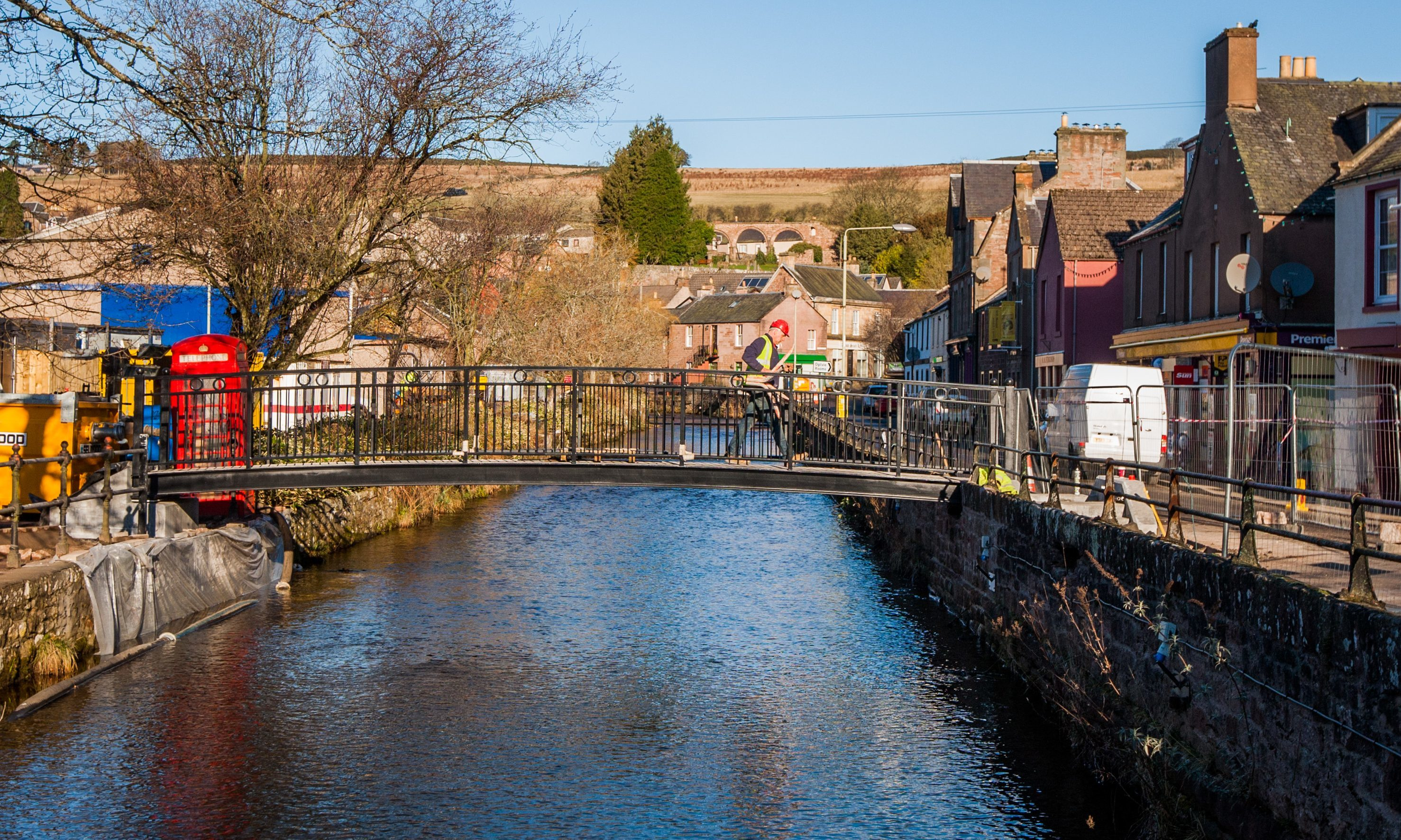 New bridges in place over Alyth Burn.  Picture shows workmen using one of the new bridges.