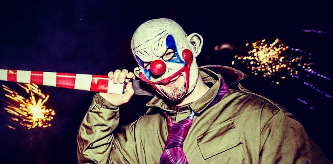 One of the actors dressed as a creepy clown in preparation for the event.