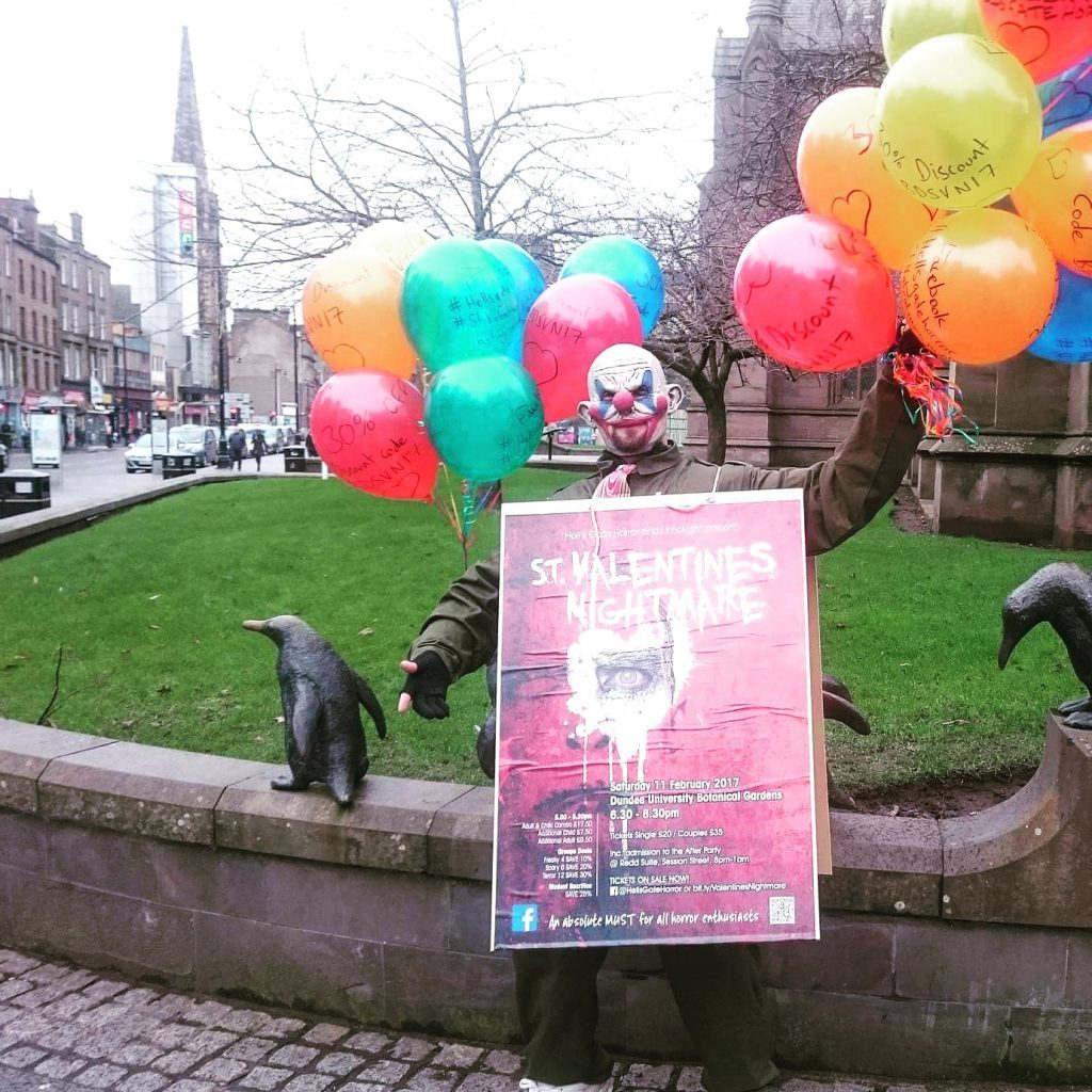 A creepy clown doing publicity work for the event at Dundee City Centre.