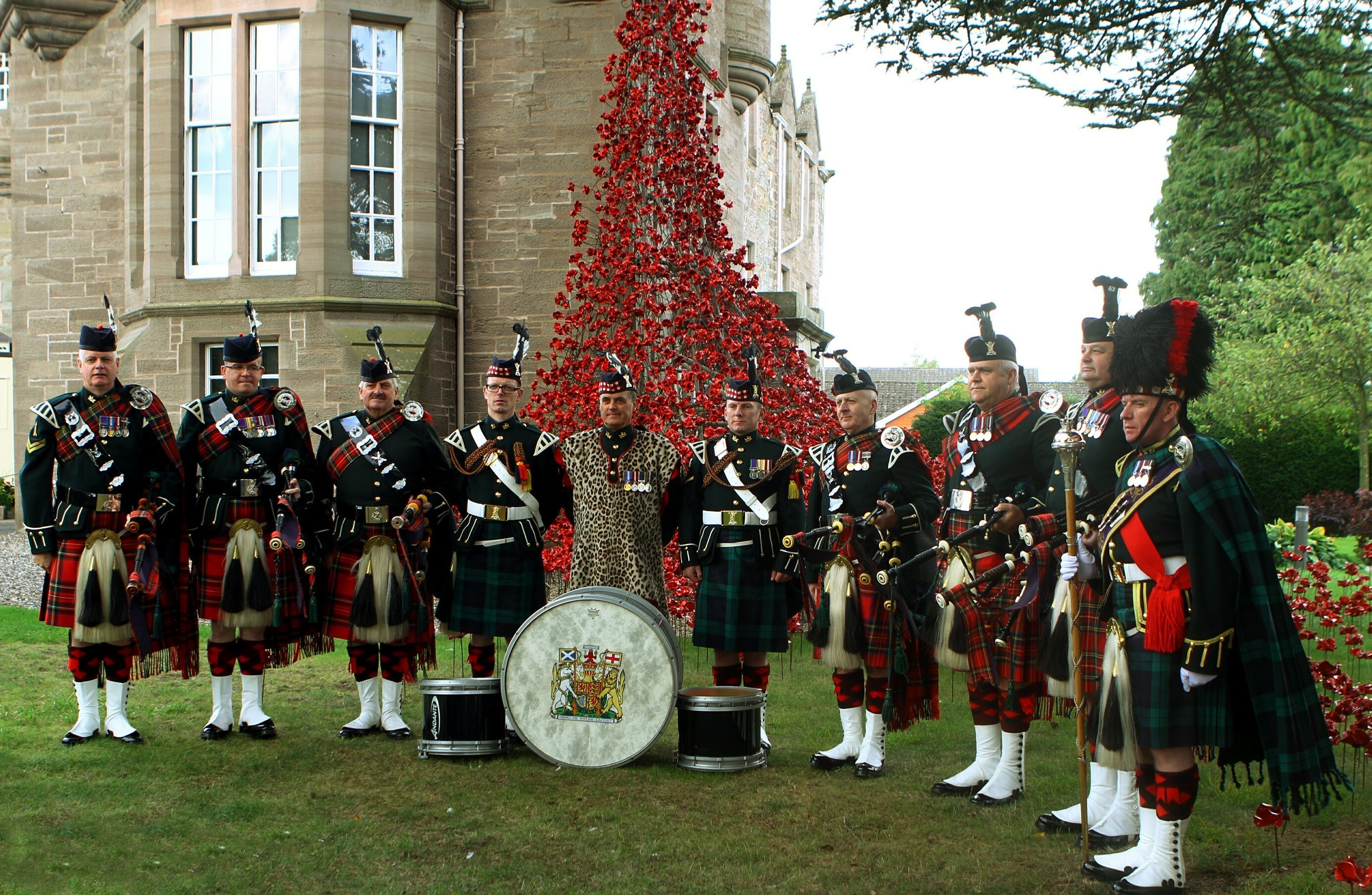 Drums of the 51st Highland, 7th Battalion Royal Regiment of Scotland, beside the poppies at The Black Watch Castle.