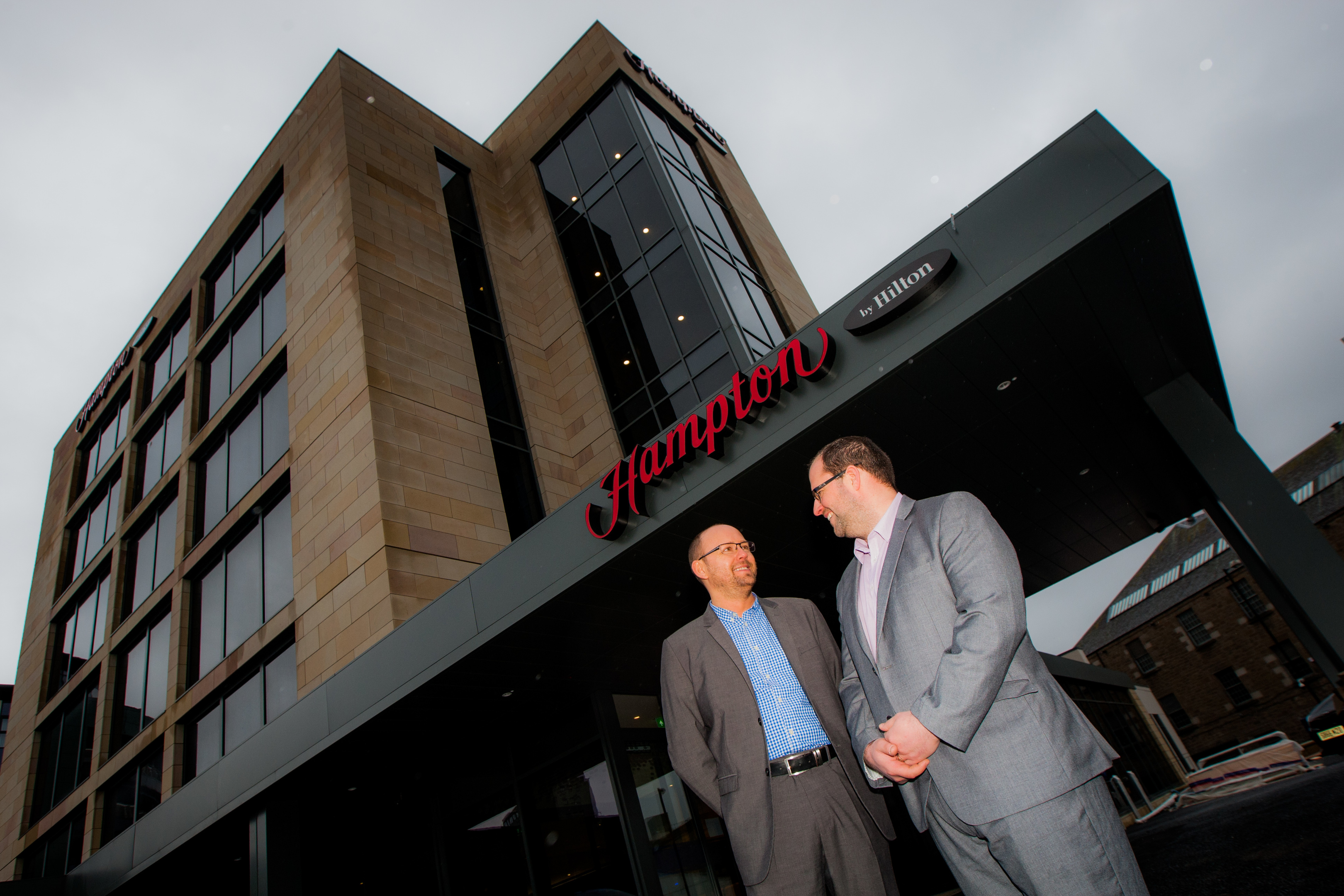 General manager Paul Wood and director of sales Derek Miller in front of the new Hampton by Hilton hotel.