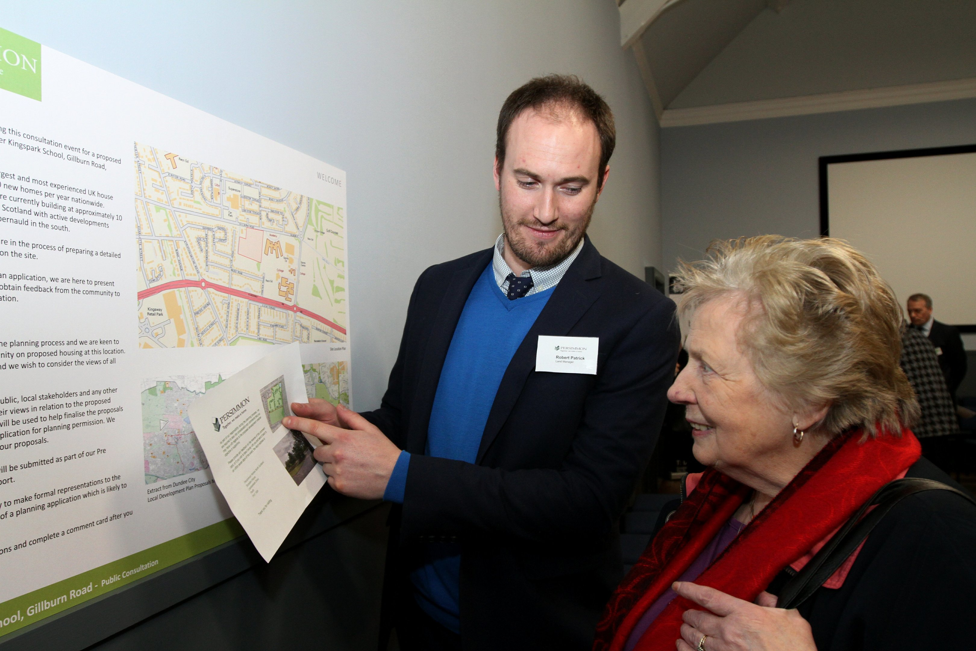 Land manager Robert Patrick talks campaigner Peggy George through the plans.