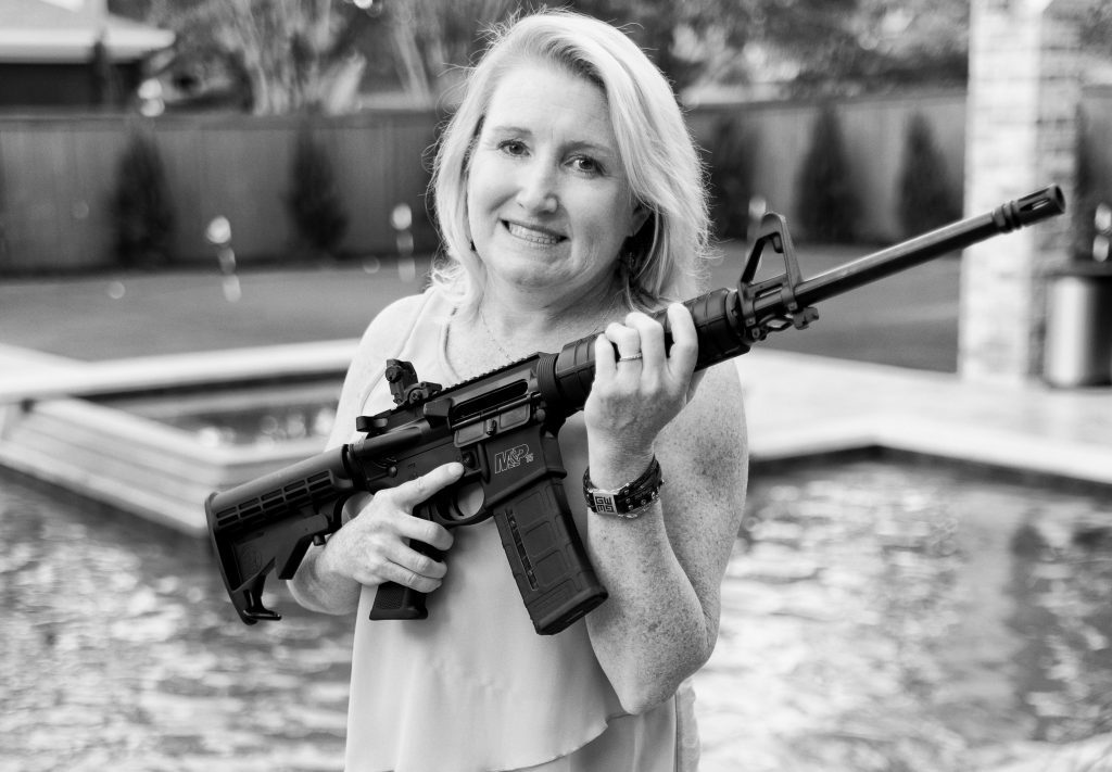 Katie Bax Richardson of Southlake, TX holding her AR-15 assault rifle outside her home.