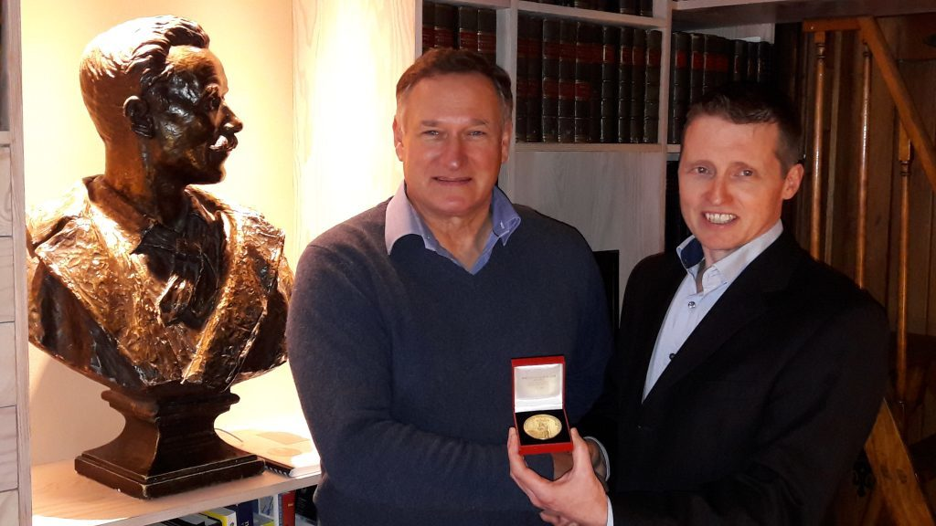 Sir David Hempleman-Adams receives the prestigious Scottish Geography Medal from Royal Scottish Geographical Society chief executive Mike Robinson in Perth