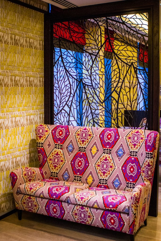 The restaurant features bright colours and patterns evoking different cultures.