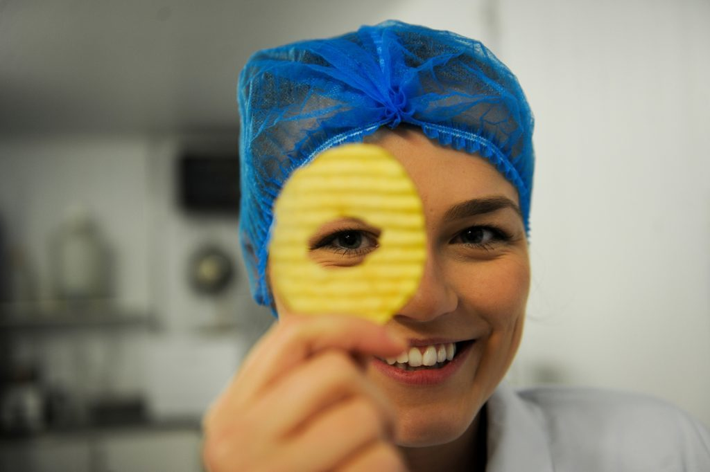 Marketing manager Dani McCann with one of the cored crisps that are assessed in the lab.