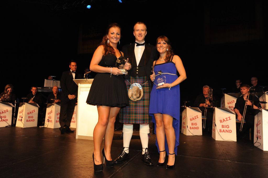 The Courier's Michael Alexander presents an award to Kirsty Yeoman and Kelly Owens at the Kingdom FM Local Hero Awards in 2013