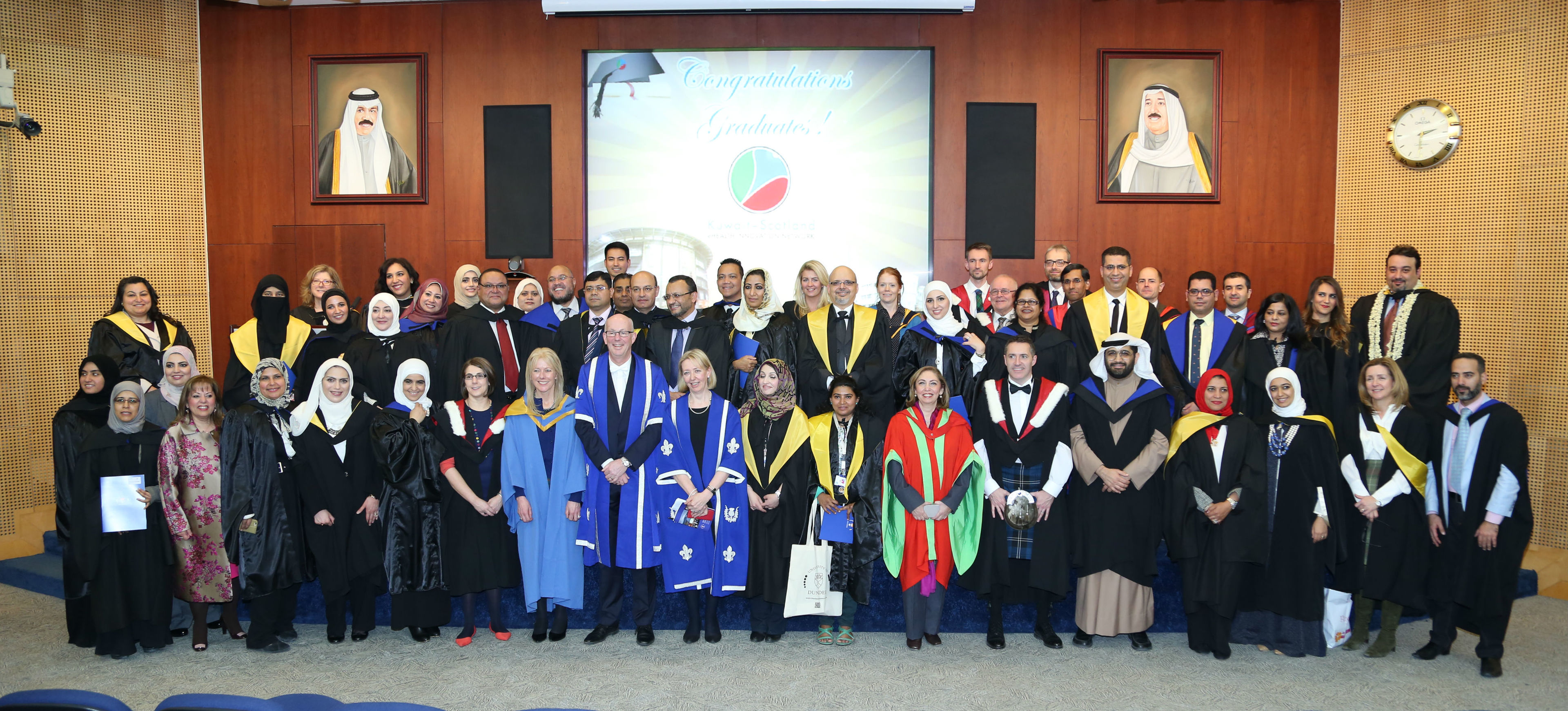 Graduates celebrating their degrees from Dundee University in Kuwait.