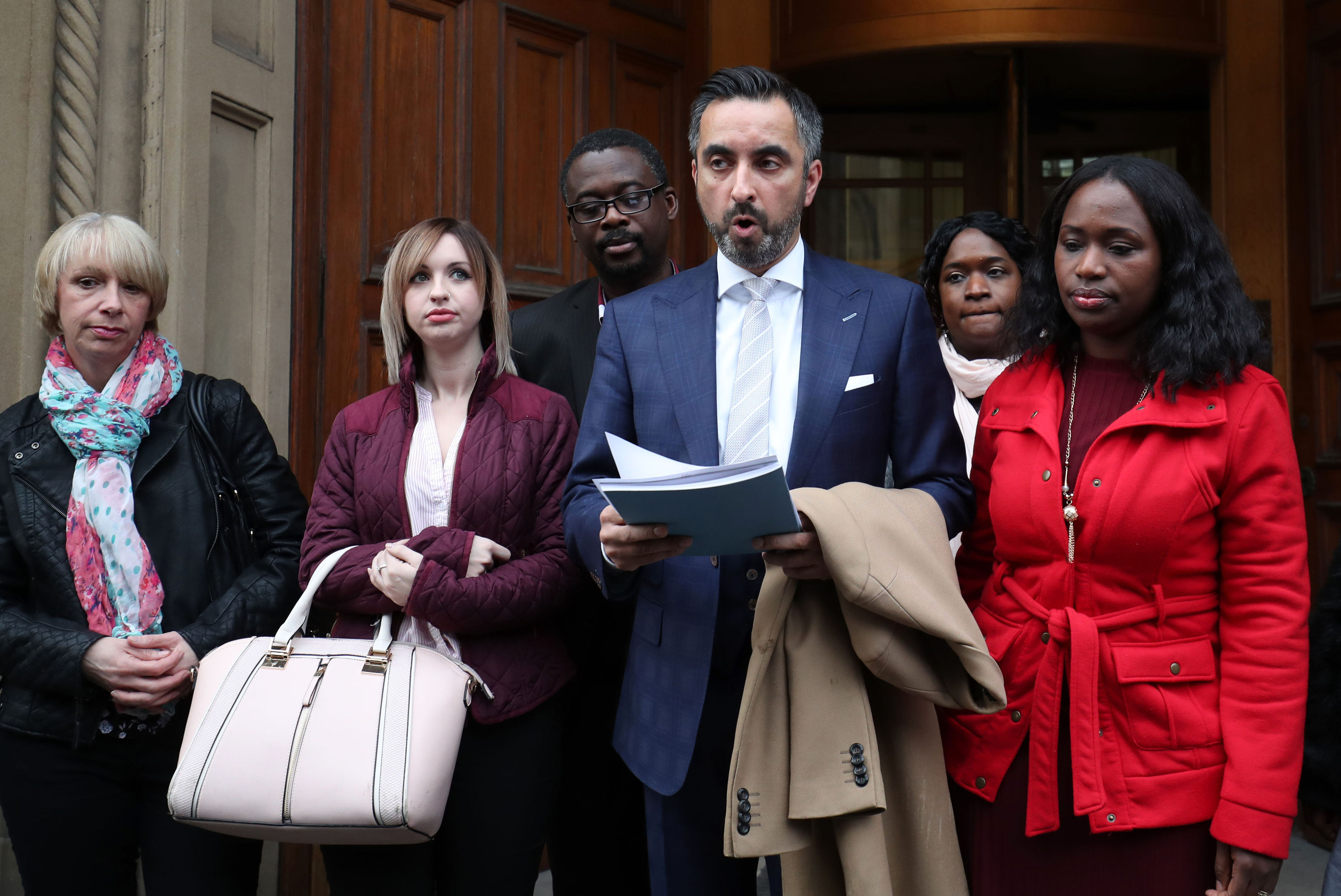Solicitor Aamer Anwar reads a statement to the media outside the Crown Office in Edinburgh after family members of the late Sheku Bayoh met the Lord Advocate.