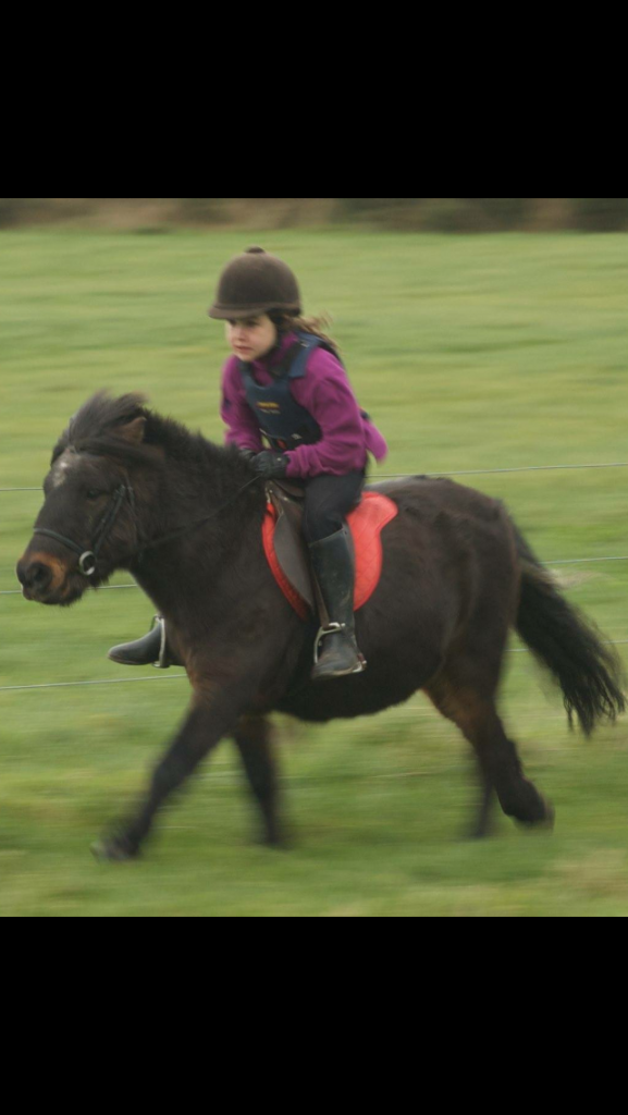 A very young Maisie on a small pony.