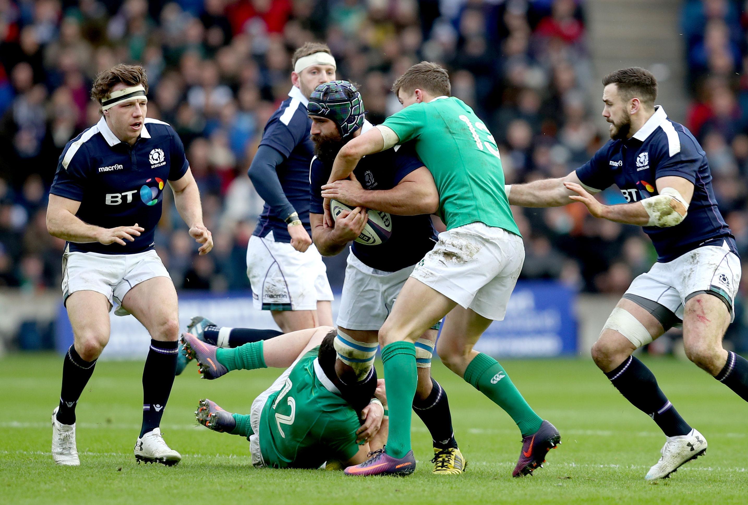 Scotland's Josh Strauss is tackled by Ireland's Garry Ringrose at Murrayfield.
