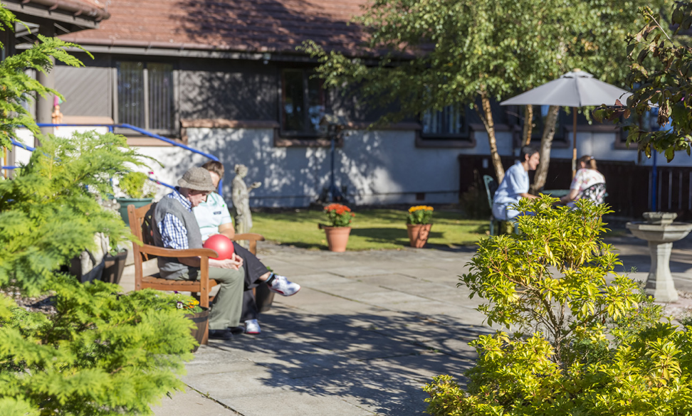 A promotional image for the Rosemount Care Home.