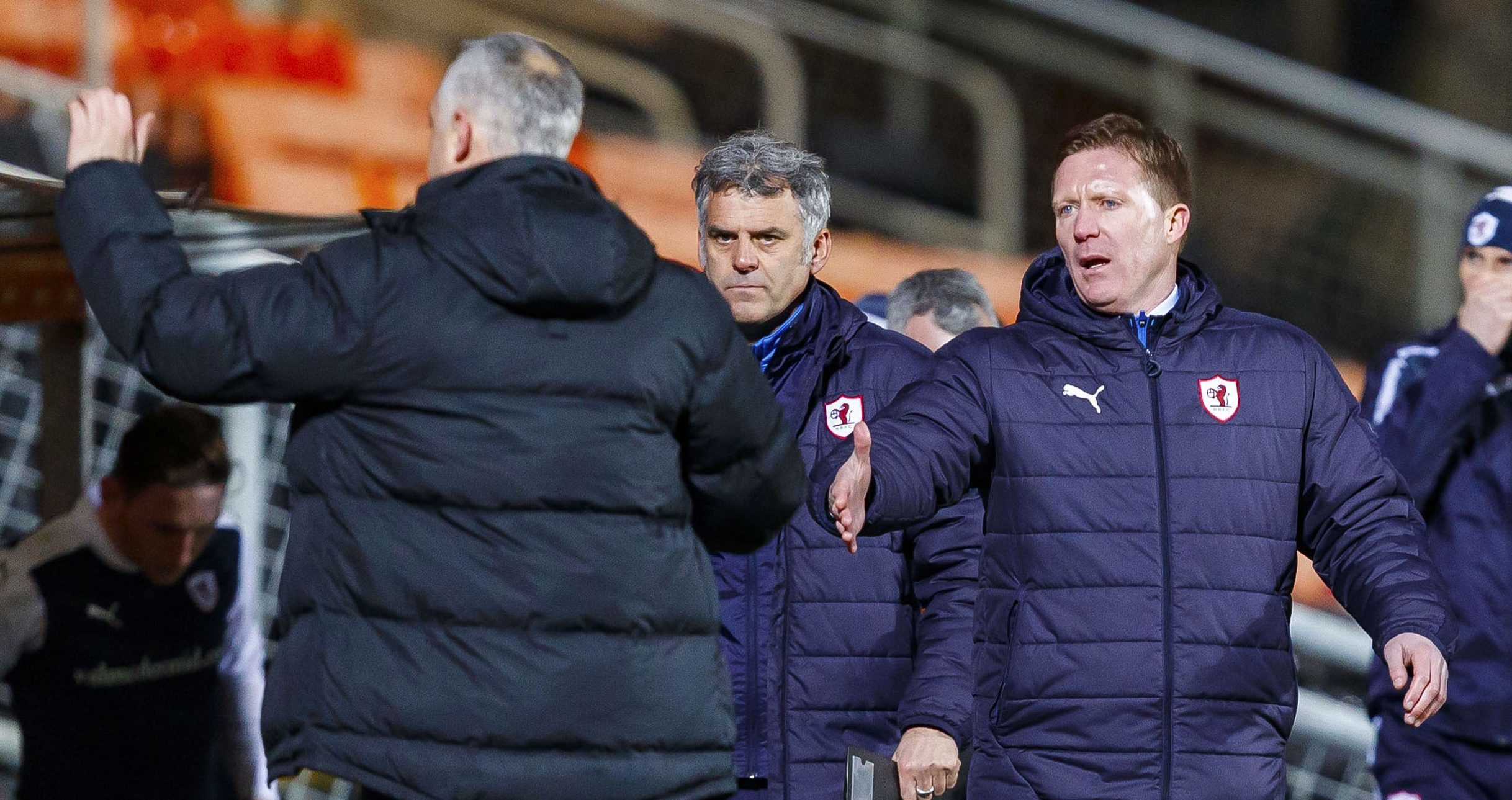 Gary Locke goes to shake hands with opposite number Ray McKinnon at the final whistle.