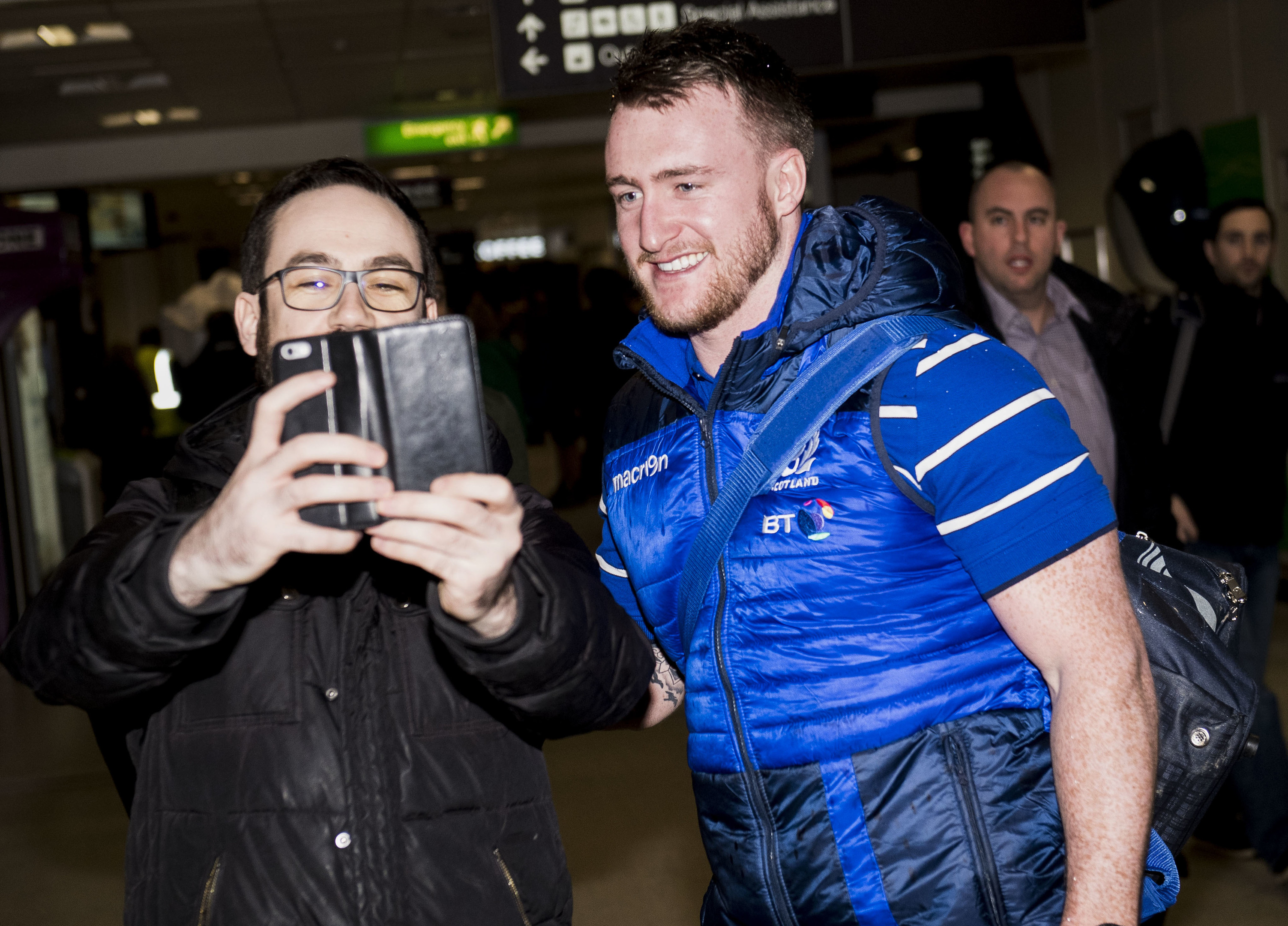 Stuart Hogg, who wins his 50th cap against France, shares a selfie with a fan at Edinburgh Airport.