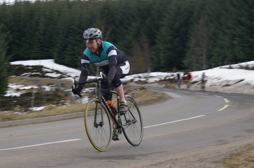 Scot going downhill on a fixed gear. You can't stop pedalling!