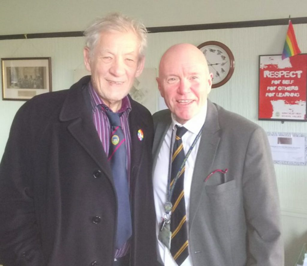Sir Ian, sporting a KHS tie, with rector Derek Allan.