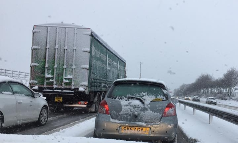 Cars have been stationary on the M80 outside Glasgow for over two hours as gritters struggle to reach the area.