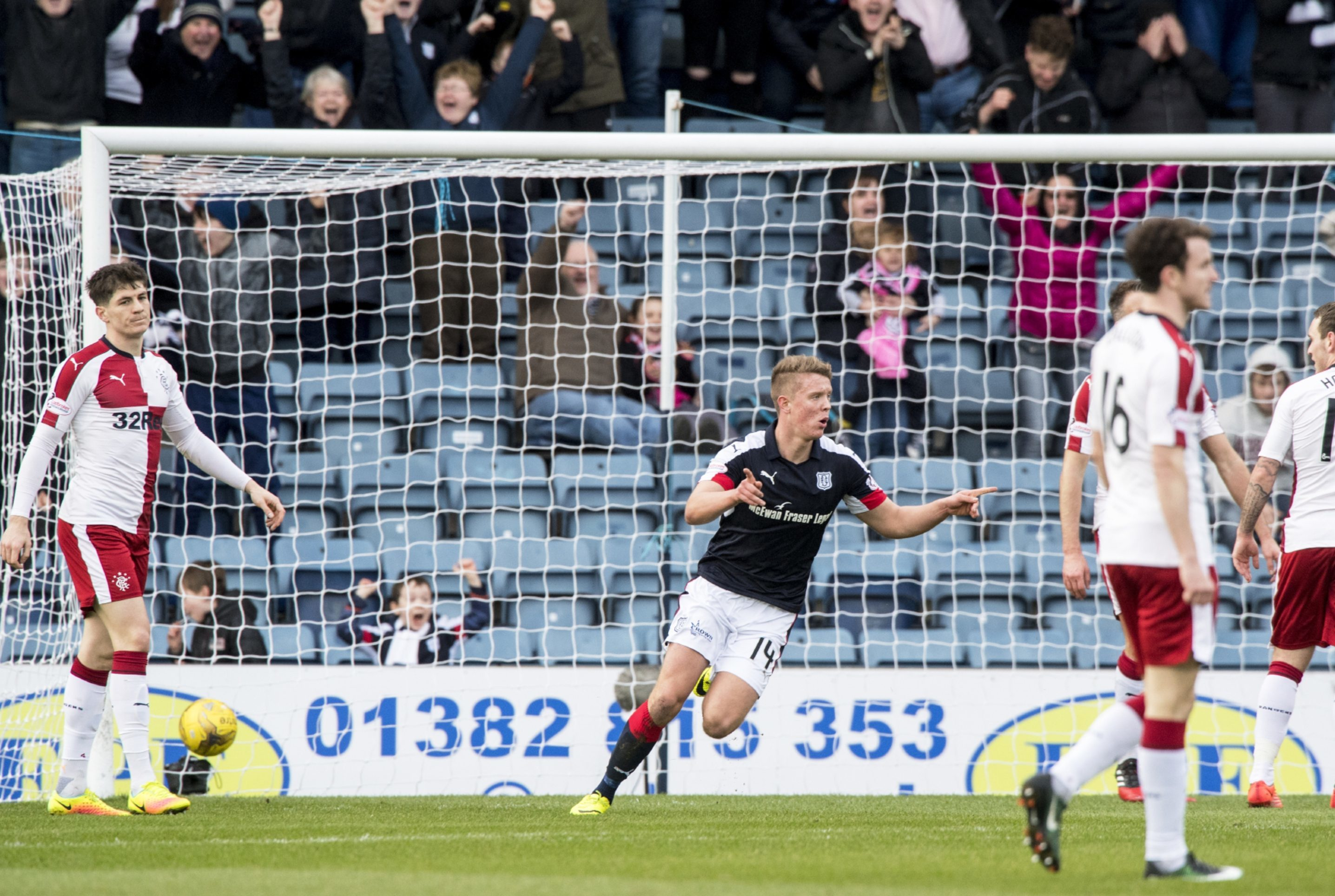 Mark O'Hara celebrates opening the scoring for Dundee.