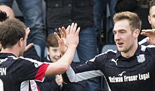 Dundee players celebrate after Kevin Holt scores their second.