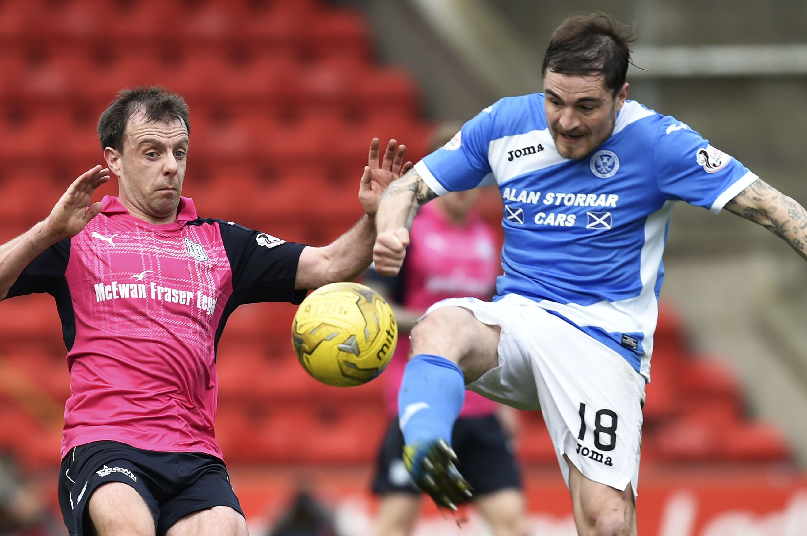 Paul Paton battles for the ball with Dundee's Paul McGowan.