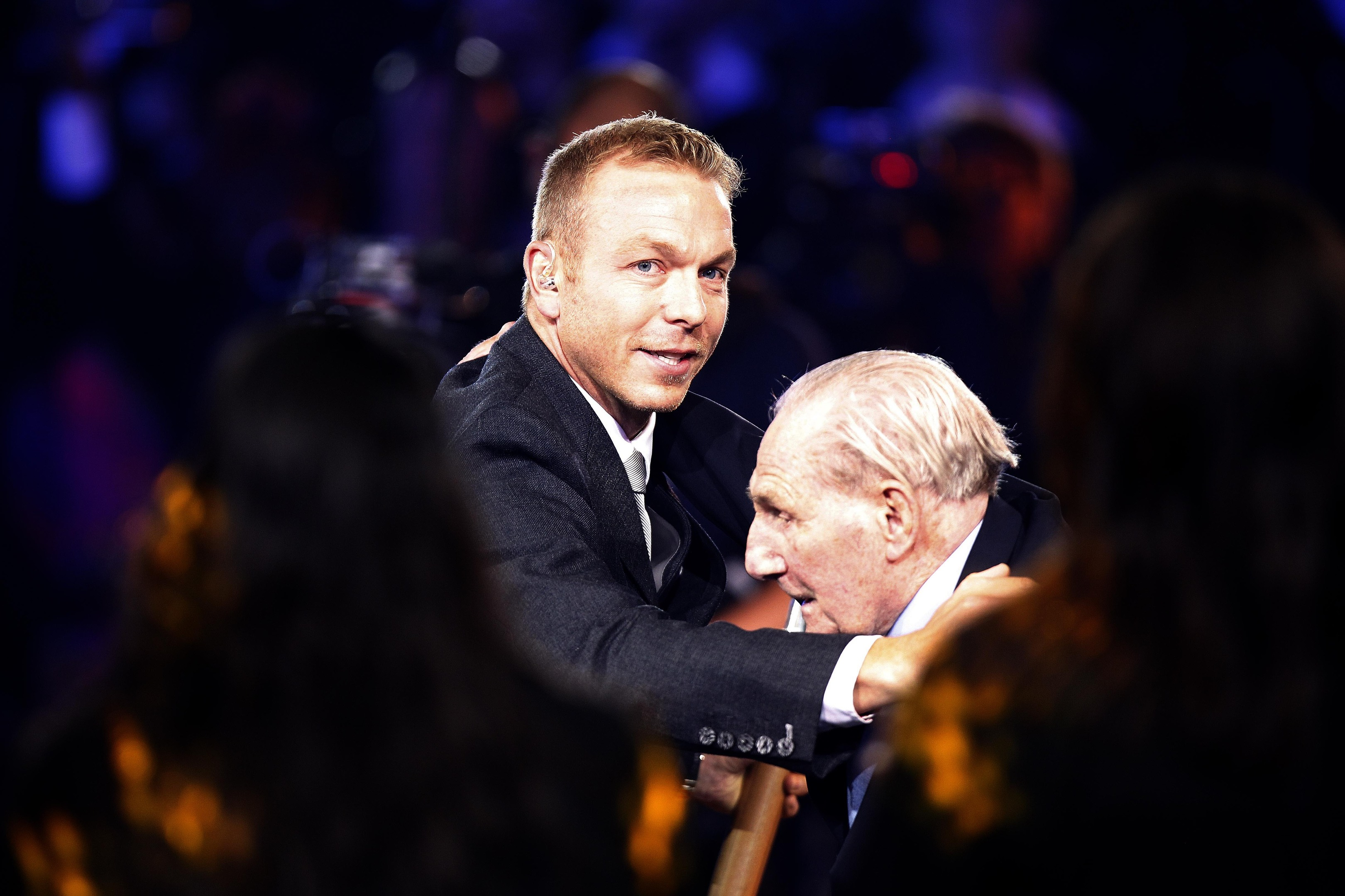 Sir Chris Hoy embracing his uncle Andy Coogan during the 2014 Commonwealth Games opening ceremony in Glasgow.