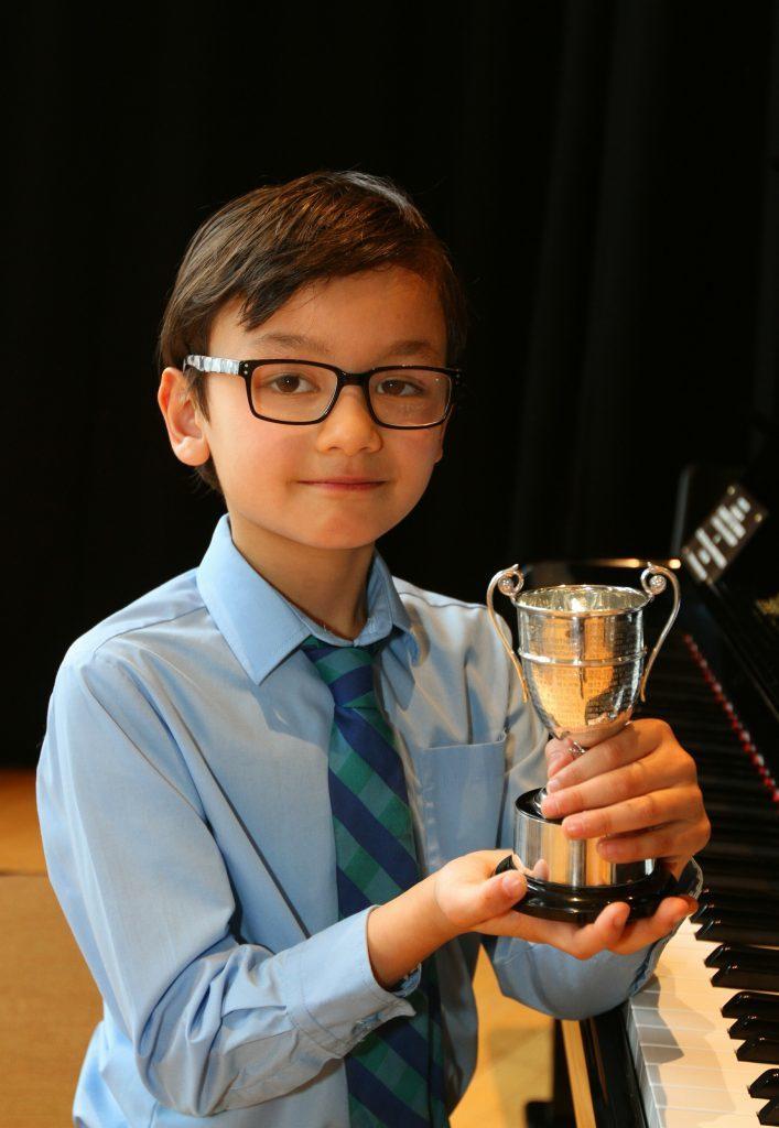 Aidan Mcfarlane with his trophy.