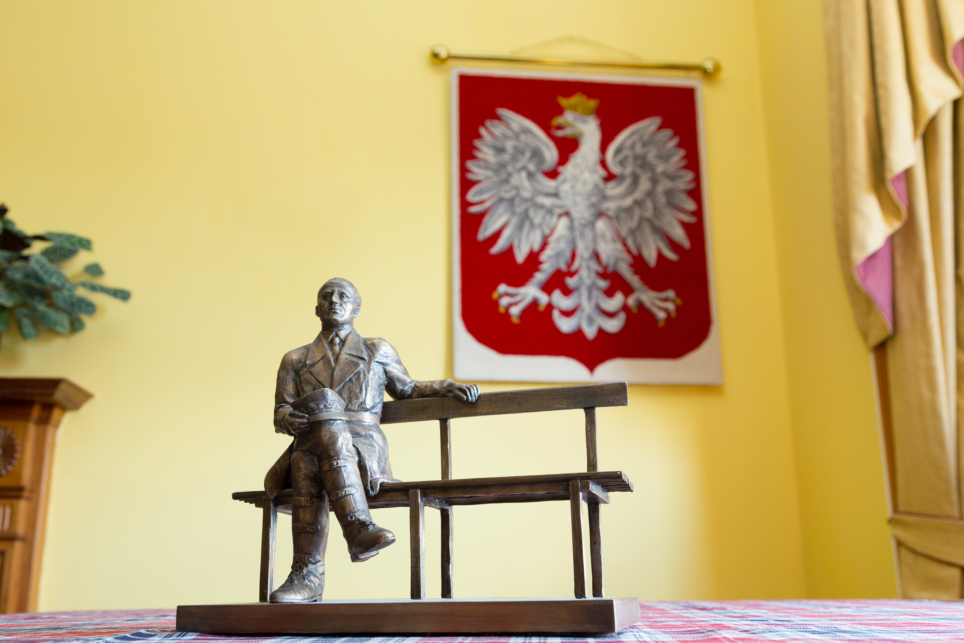 The maquette of General Stanislaw Maczek laid on Polish tartan.