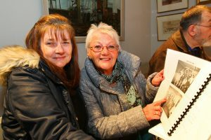 Mr Ratcliffe's wife Sheila and daughter Alison look through some of his photographs on display.