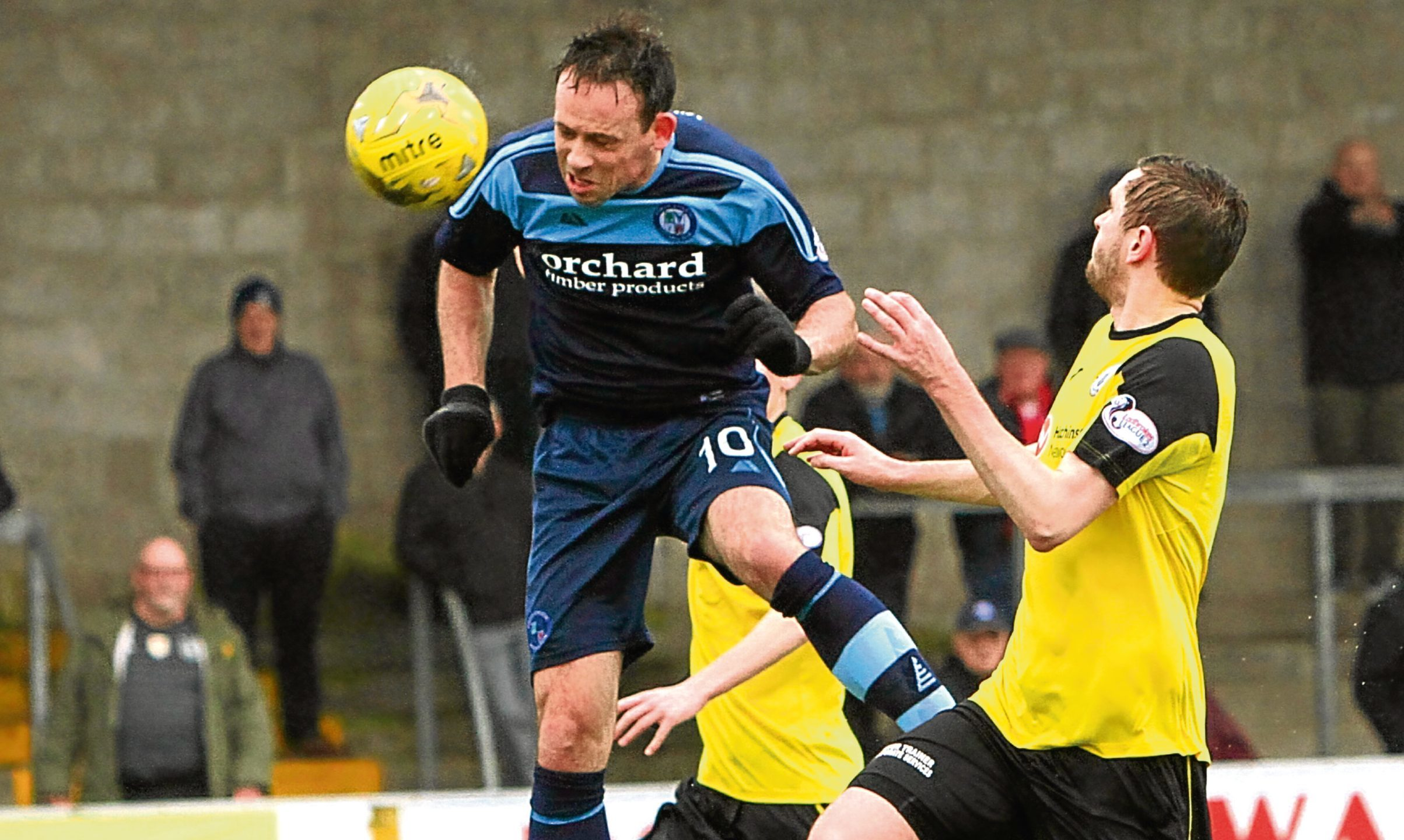 Jim Lister heads for goal to make it 1-0 to Forfar.