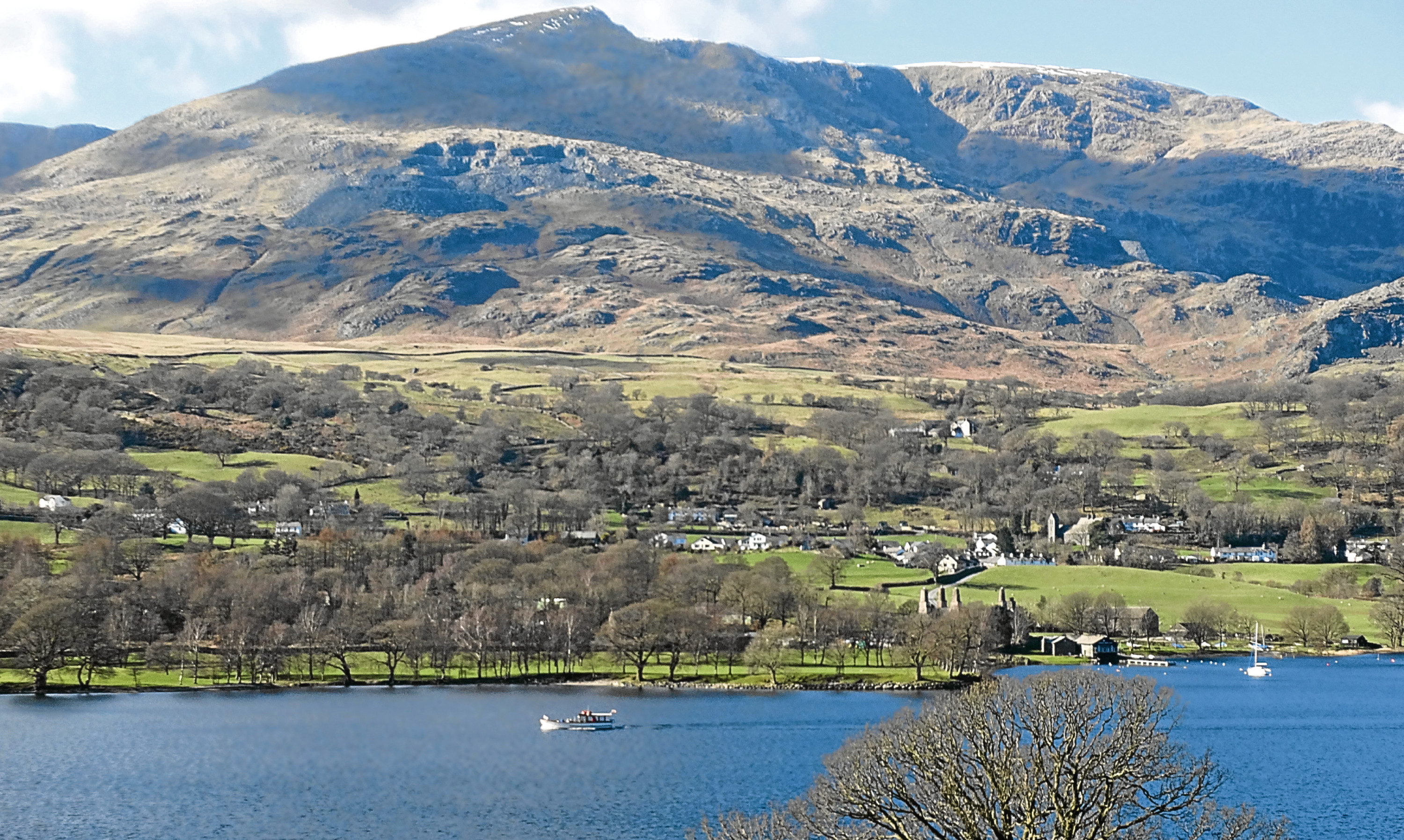 Coniston Old Man in the Lake District, with an eyebrow of snow along the summit.