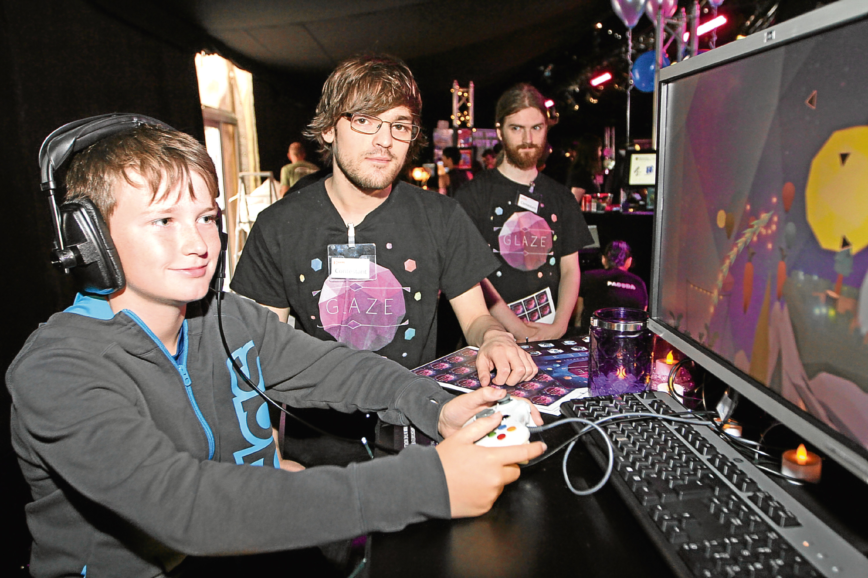 Young  fan Ross Craik checks out a new game at the 2016 Dare Proptoplay festival in Dundee