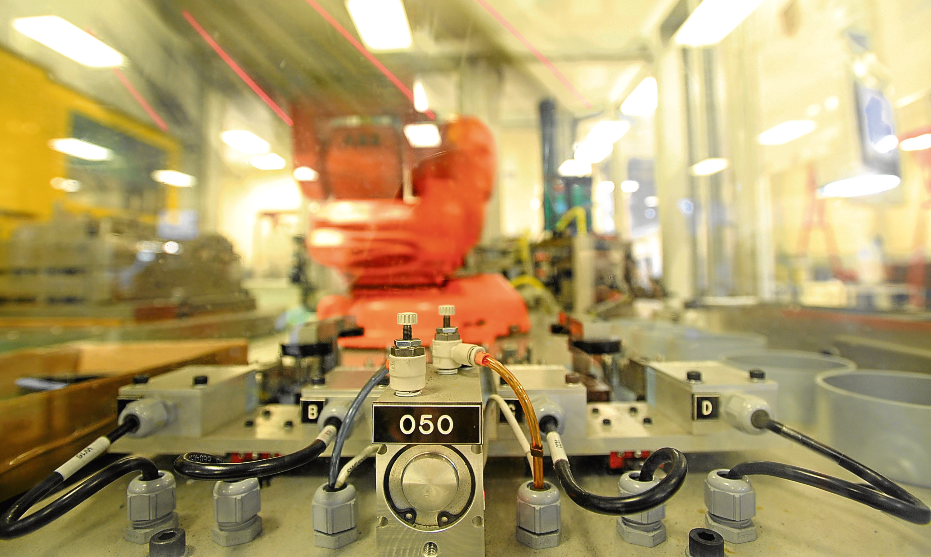 A high speed production robot in action at Angus engineering group Interplex PMP.