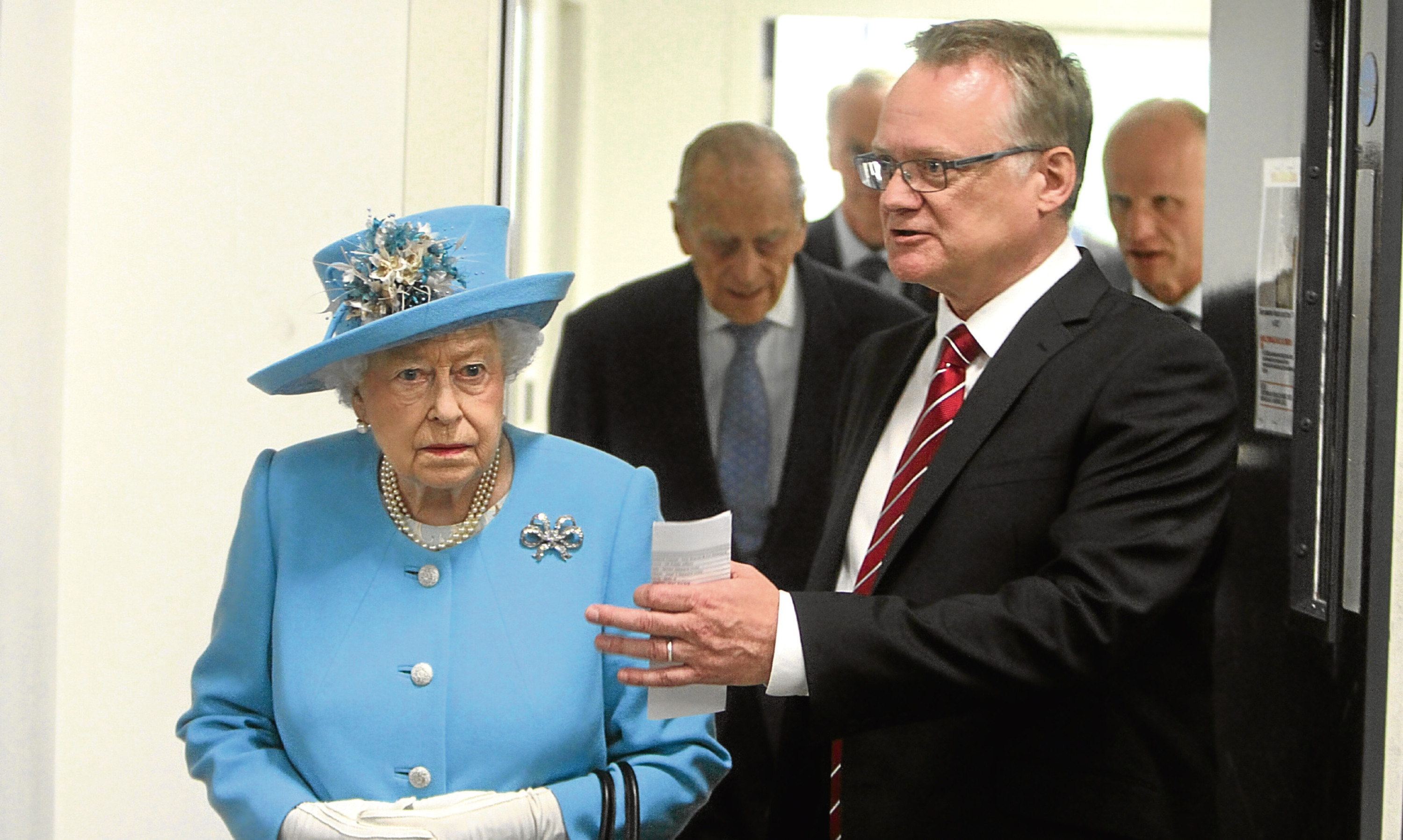 Michelin manager John Reid escorts Her Majesty The Queen on a tour of Michelin's Dundee factory