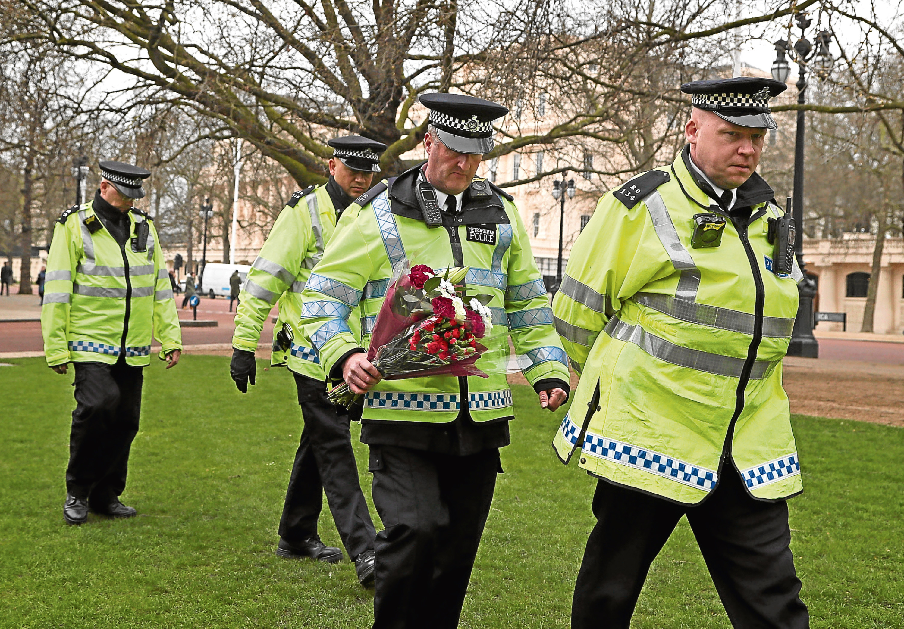Officers prepare to lay floral tributes at the National Police Memorial in London. Picture: PA.