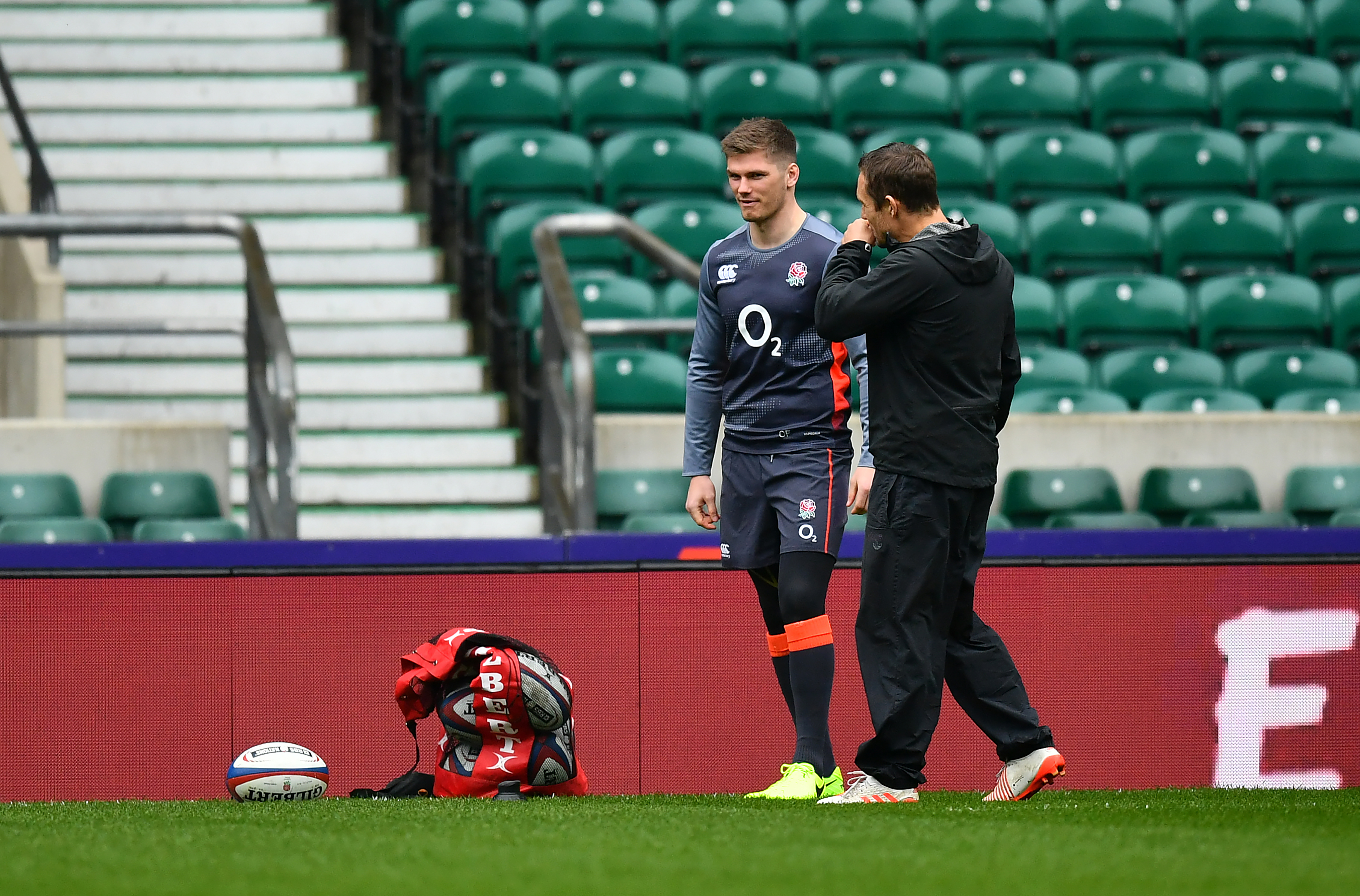 Owen Farrell, seen at Twickenham yesterday with coach Jonny Wilkinson, took no part in the final training session.