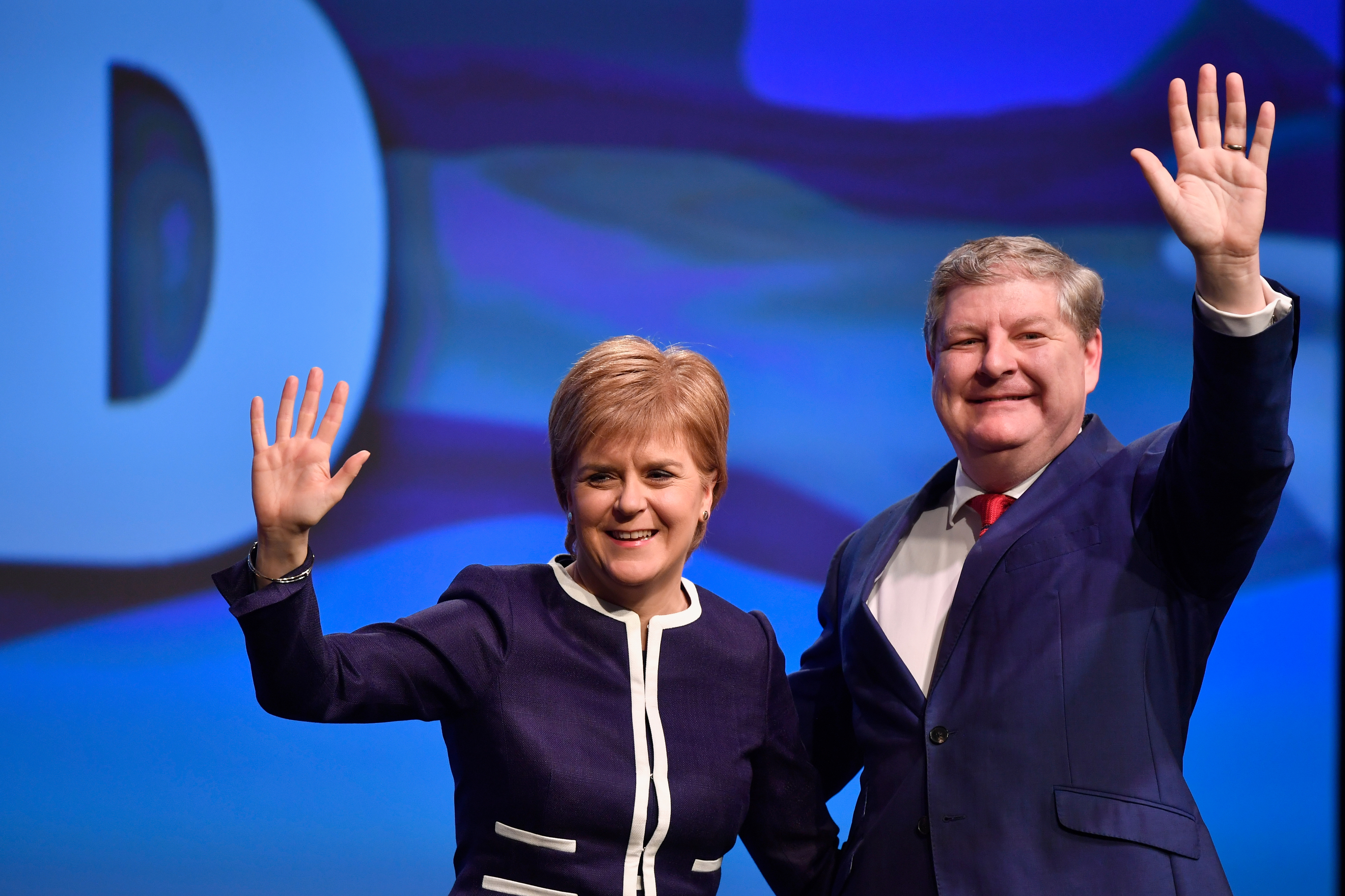 First Minister Nicola Sturgeon, and Angus Robertson, deputy SNP leader, acknowledge applause after addressing delegates at the SNP spring conference in Aberdeen.