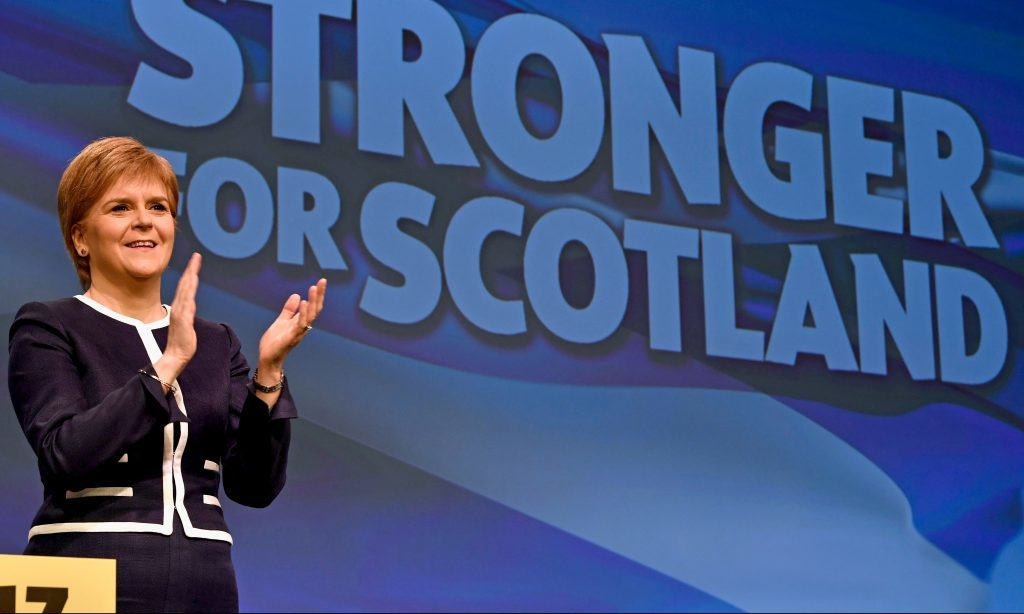 Nicola Sturgeon on stage on the first day of the SNP conference.