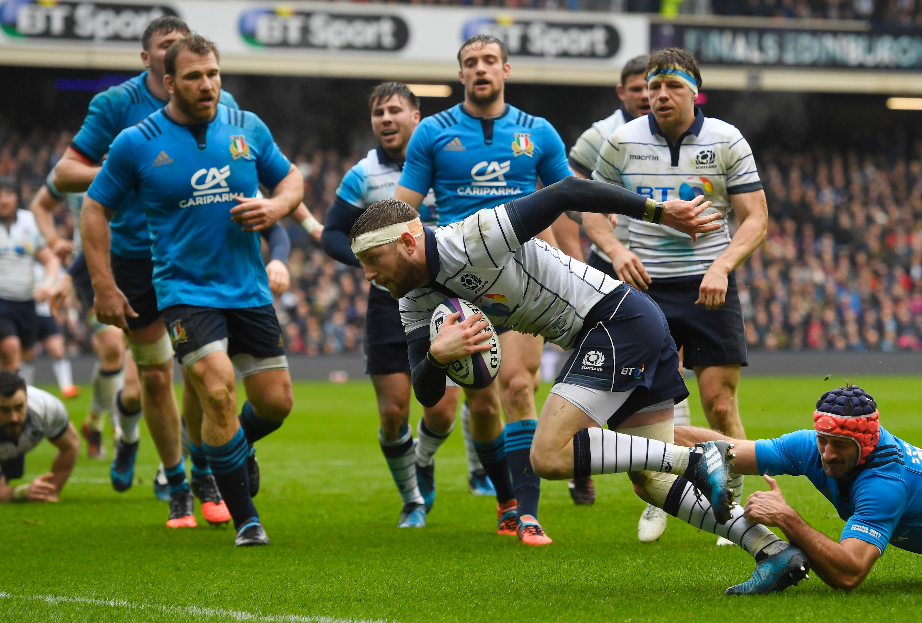 Finn Russell scores against Italy at Murrayfield last year.