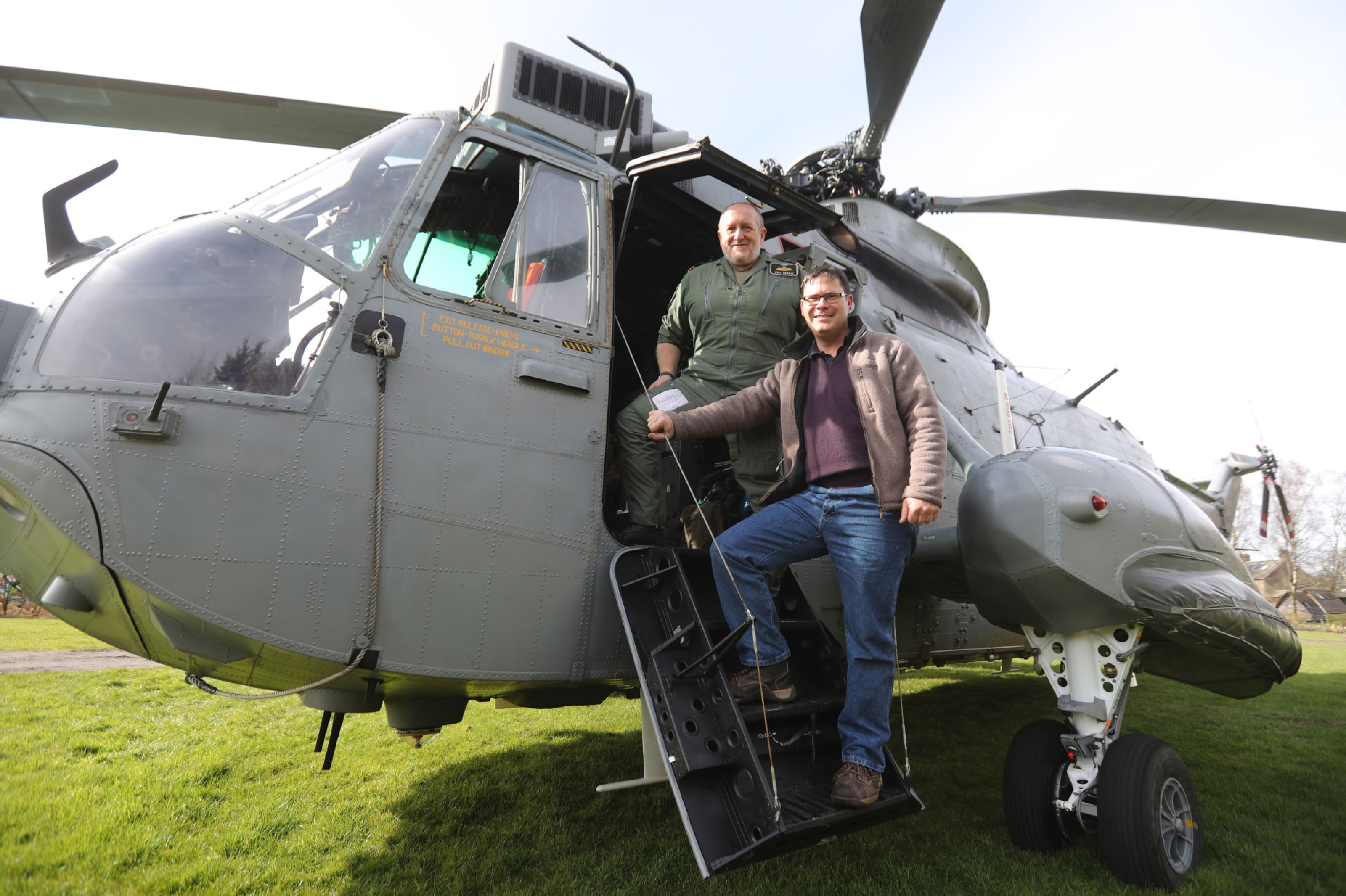 "Lt Cdr Andy Murray (left, who has flown the converted  helicopter many times when it was in active duty at RNAS Culdrose) shows  Martyn Steedman his current helicopter during a visit to see the converted one it at its new base at Mains Farm Wigwams  in Thornhill. PRESS ASSOCIATION Photo. Picture date: Friday March 24, 2017. Lieutenant Commander Andy ""Tank"" Murray and his crew stopped off to visit the Sea King near Stirling as they flew north to take part in a training exercise. See PA story AIR SeaKing. Photo credit should read: Andrew Milligan/PA Wire"