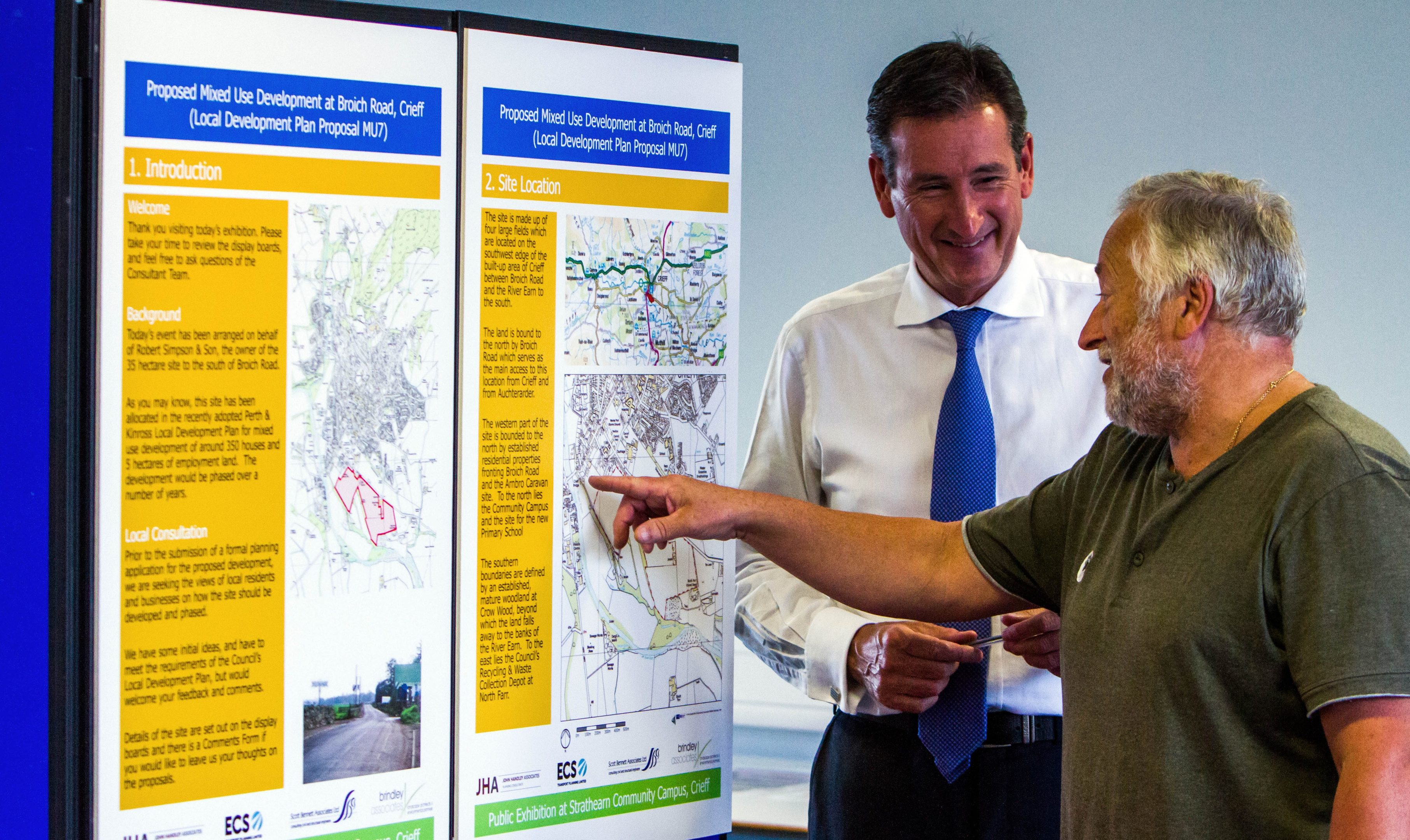 Public exhibition on proposals for the Broich Road development at Crieff. Pictured, Kim Marshall (right, from Crieff) chats to Alston Birnie (left, planning consultant for landowner Robert Simpson and Sons Ltd).