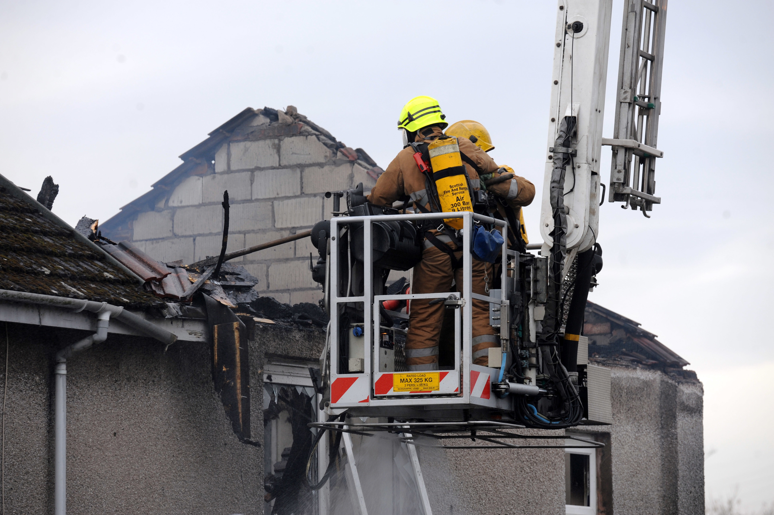 Firefighters take control of the blaze.