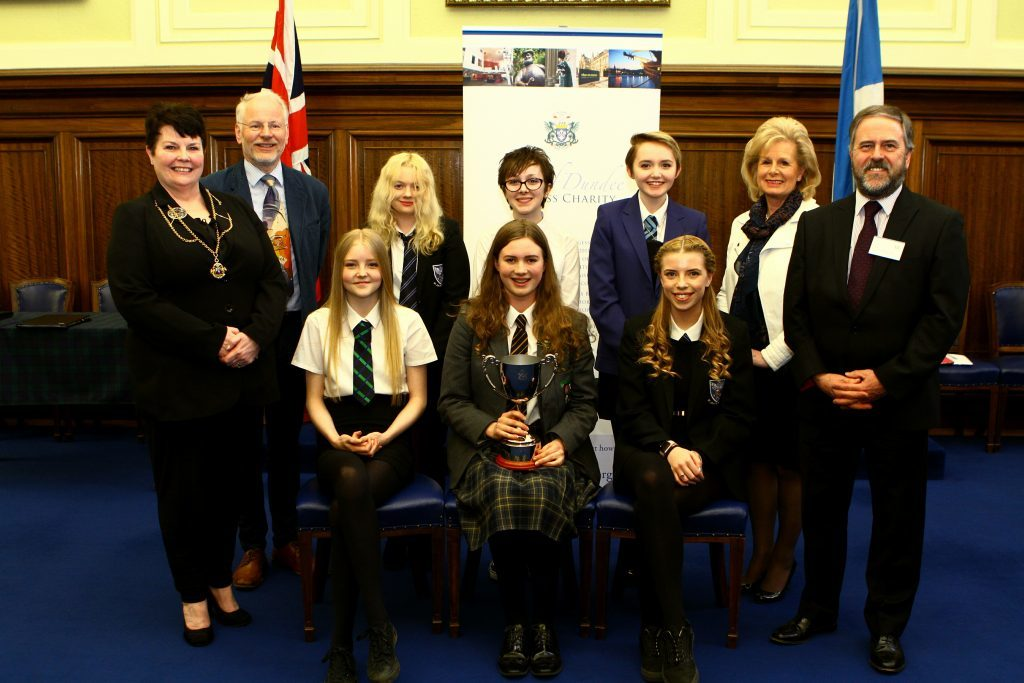 Winner Emily Baxter (front centre with her trophy) and runners-up Callie Hay (front left) and Jessica Mannion (front right). Also pictured (back, from left) Depute Provost Christina Roberts, chairman of the judges Donald Gordon, highly commended writers Lena Macauley, Carmen Thomson and Melissa McCafferty, and Burgess trustees Vivien Scott and Gary Langlands.