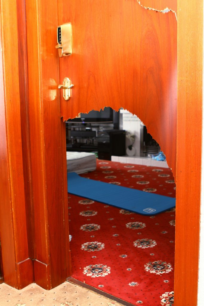 The living room door was smashed by the thieves as they gained entry to the interiror of the house