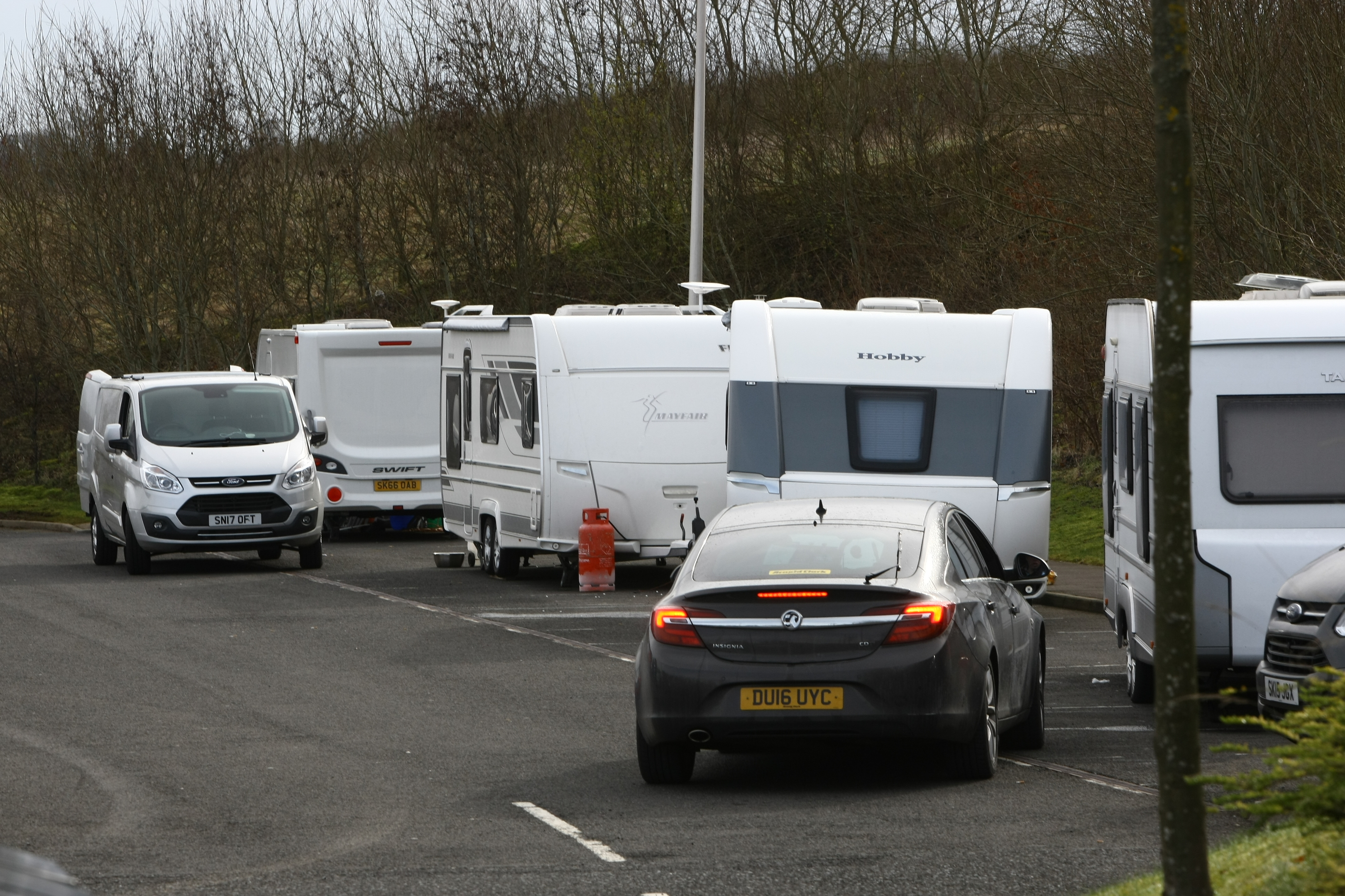 The caravans parked across dozens of spaces at Broxden park and Ride.