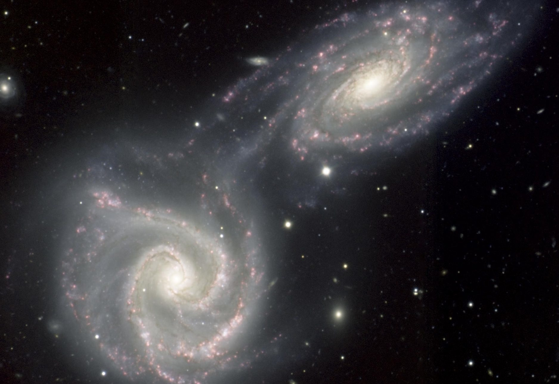 A present-day near-miss of two spiral galaxies NGC 5426 and NGC 5427, which may be comparable to the early flyby of the Andromeda Galaxy past our own.